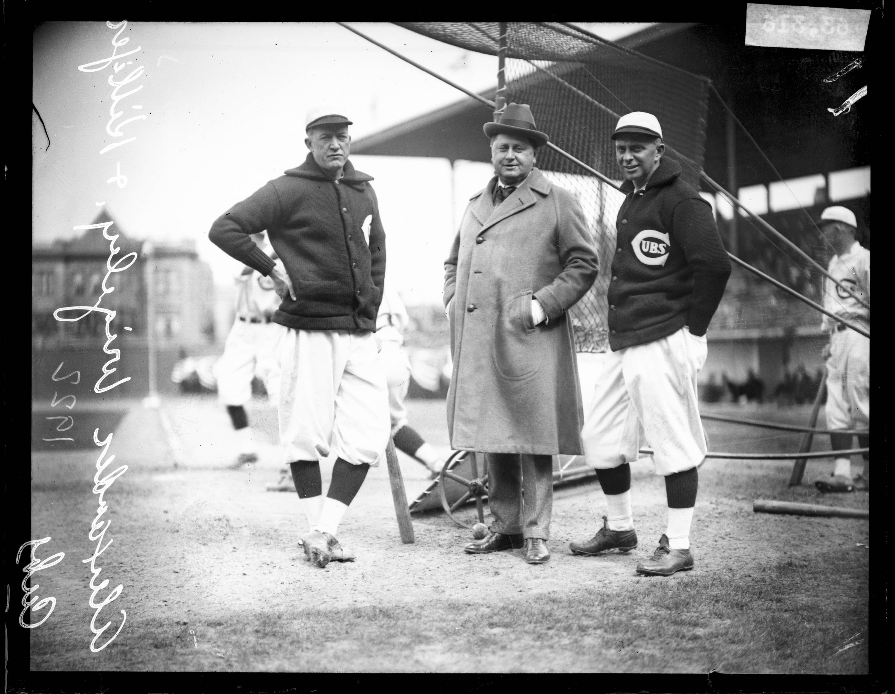 This 1922 photo shows from left, Chicago Cubs baseball player Pete Alexander, team owner William Wrigley Jr., and manager Bill Killefer standing behind a batting practice backstop on the field at Weeghman Park, in Chicago. Weeghman Park was renamed Wrigley Field in 1927.