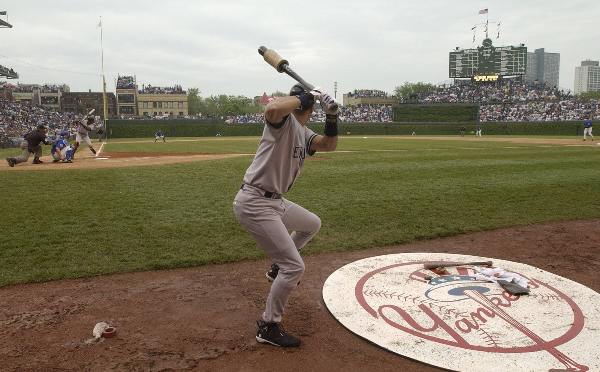 In this June 6, 2003 photo, New York Yankees' Derek Jeter warms up in the on-deck circle in a baseball game against the Chicago Cubs at Wrigley Field in Chicago.