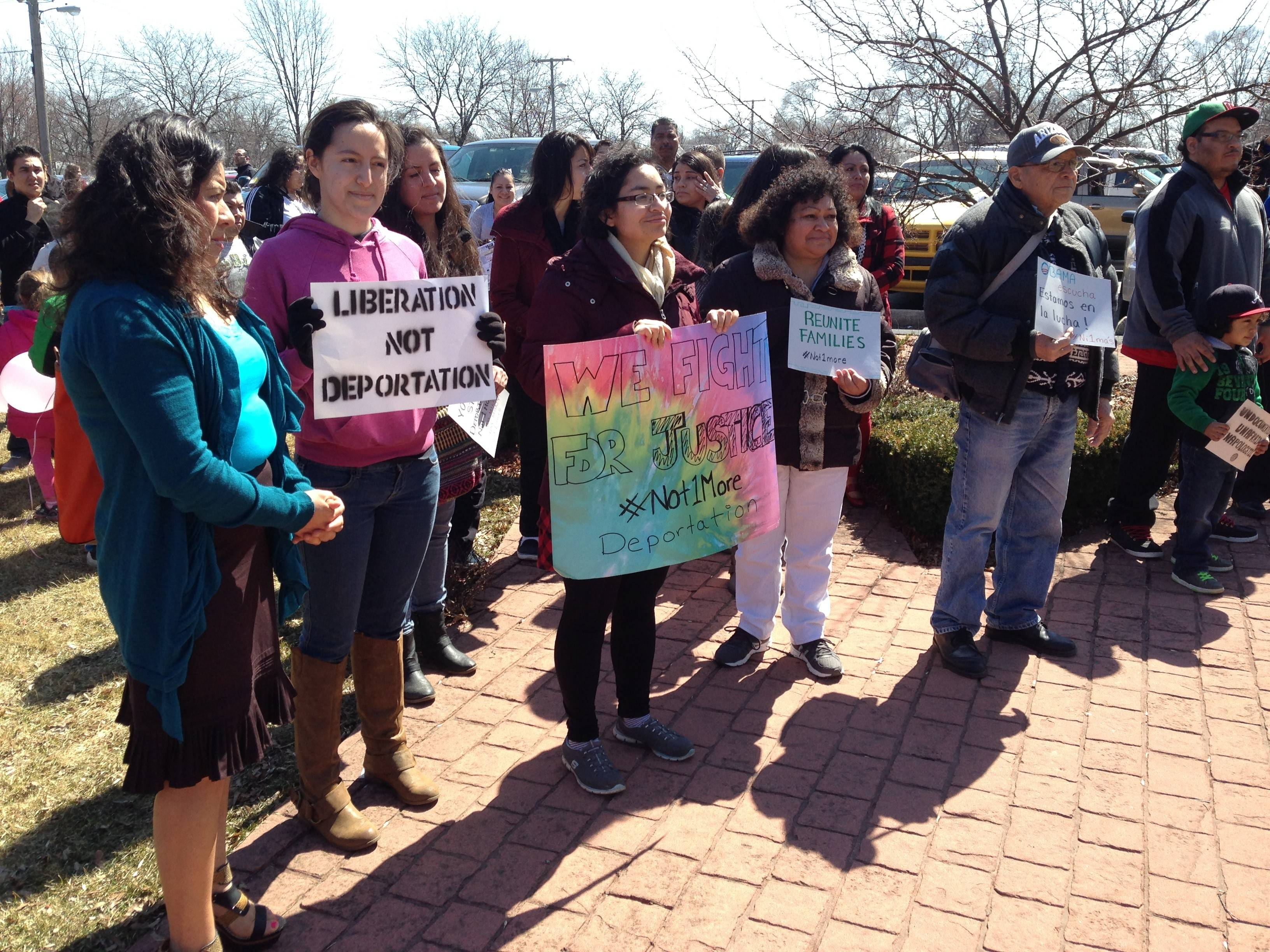 Many in the crowd at Sunday's Coming Out of the Shadows rally in Bensenville held up signs in support of ending deportations of undocumented residents.