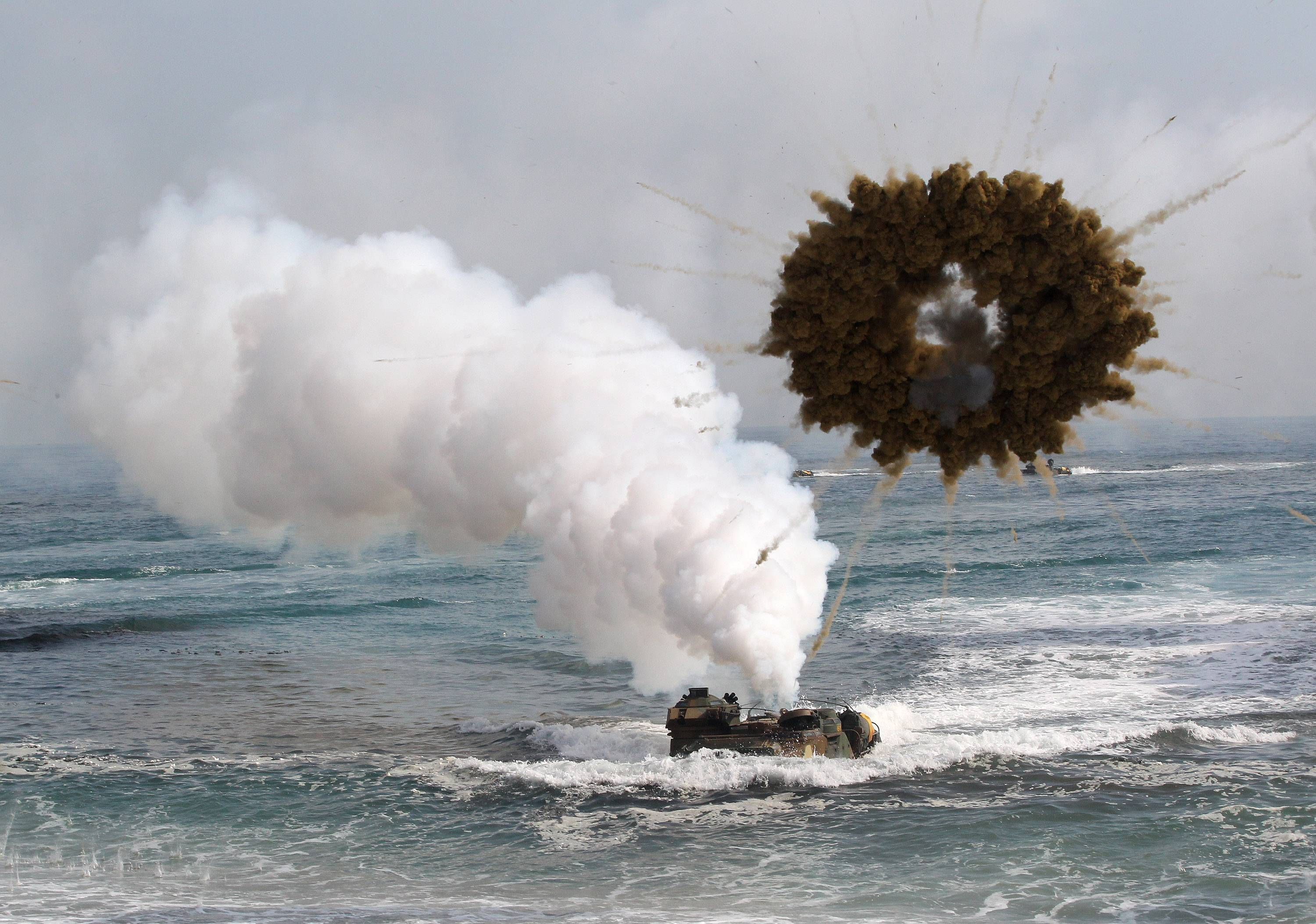 A South Korean marine LVT-7 landing craft sail to shores Monday through a smoke screen during the U.S.-South Korea joint landing exercises called Ssangyong, part of the Foal Eagle military exercises, in Pohang, South Korea. South Korea said North Korea has announced plans to conduct live-fire drills near the rivals' disputed western sea boundary. The planned drills Monday come after an increase in threatening rhetoric from Pyongyang and a series of rocket and ballistic missile launches in an apparent protest against the annual military exercises by Seoul and Washington.