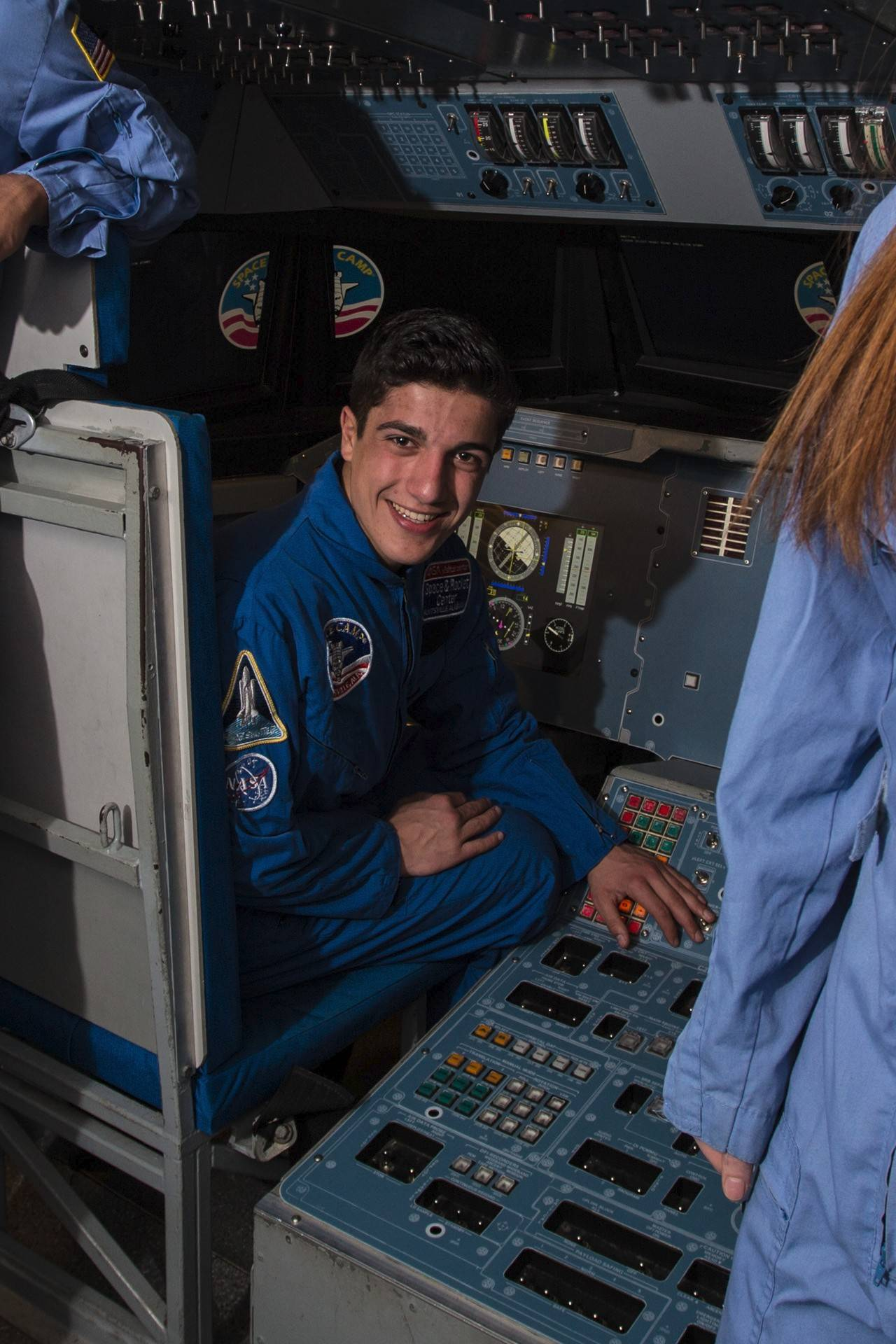 Nikitas Adamopoulos of Gurnee is at the controls of a space shuttle simulator aviation program that reinforces leadership, teamwork and decision-making while building realistic piloting skills.