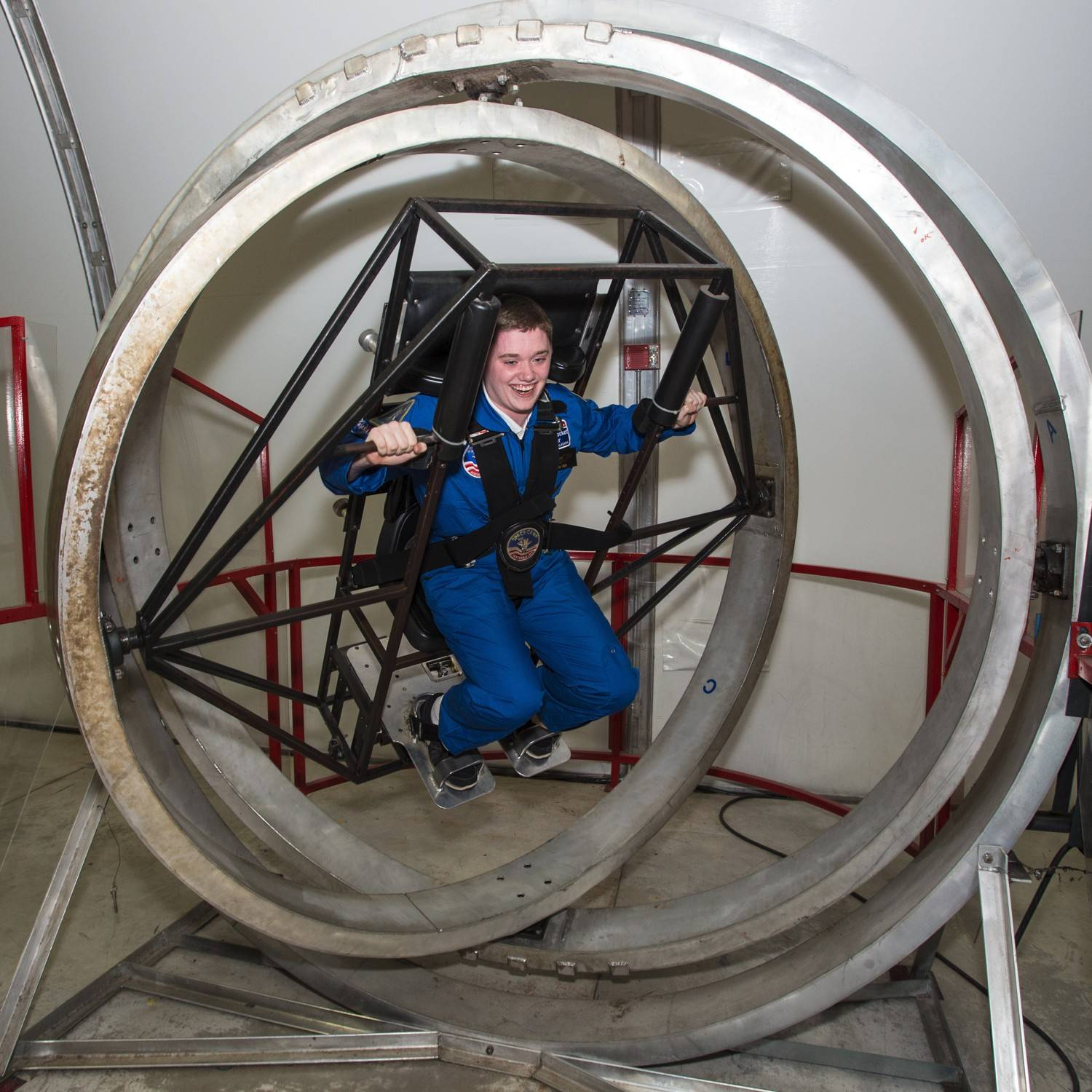 Ryan Hunt of Des Plaines is in a Multi-Axis Trainer that simulates the disorientation one would feel in a tumble spin during re-entry into the Earth's atmosphere.