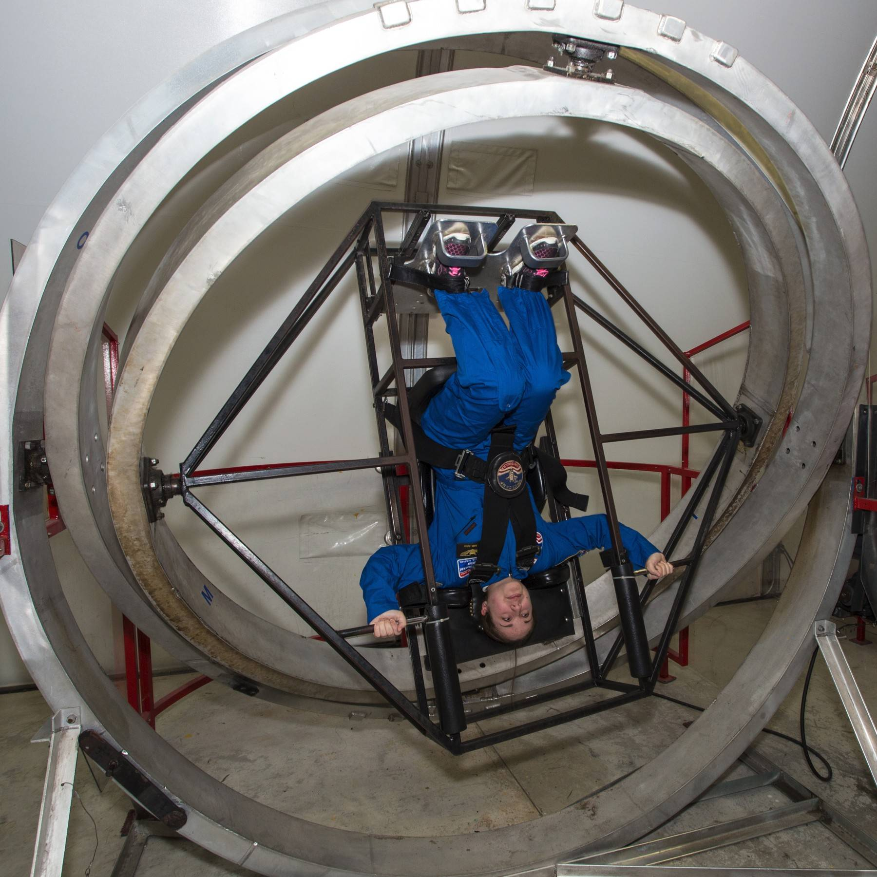 Kiara Zurow of Geneva is in a Multi-Axis Trainer that simulates the disorientation someone would feel in a tumble spin during re-entry into the Earth's atmosphere.