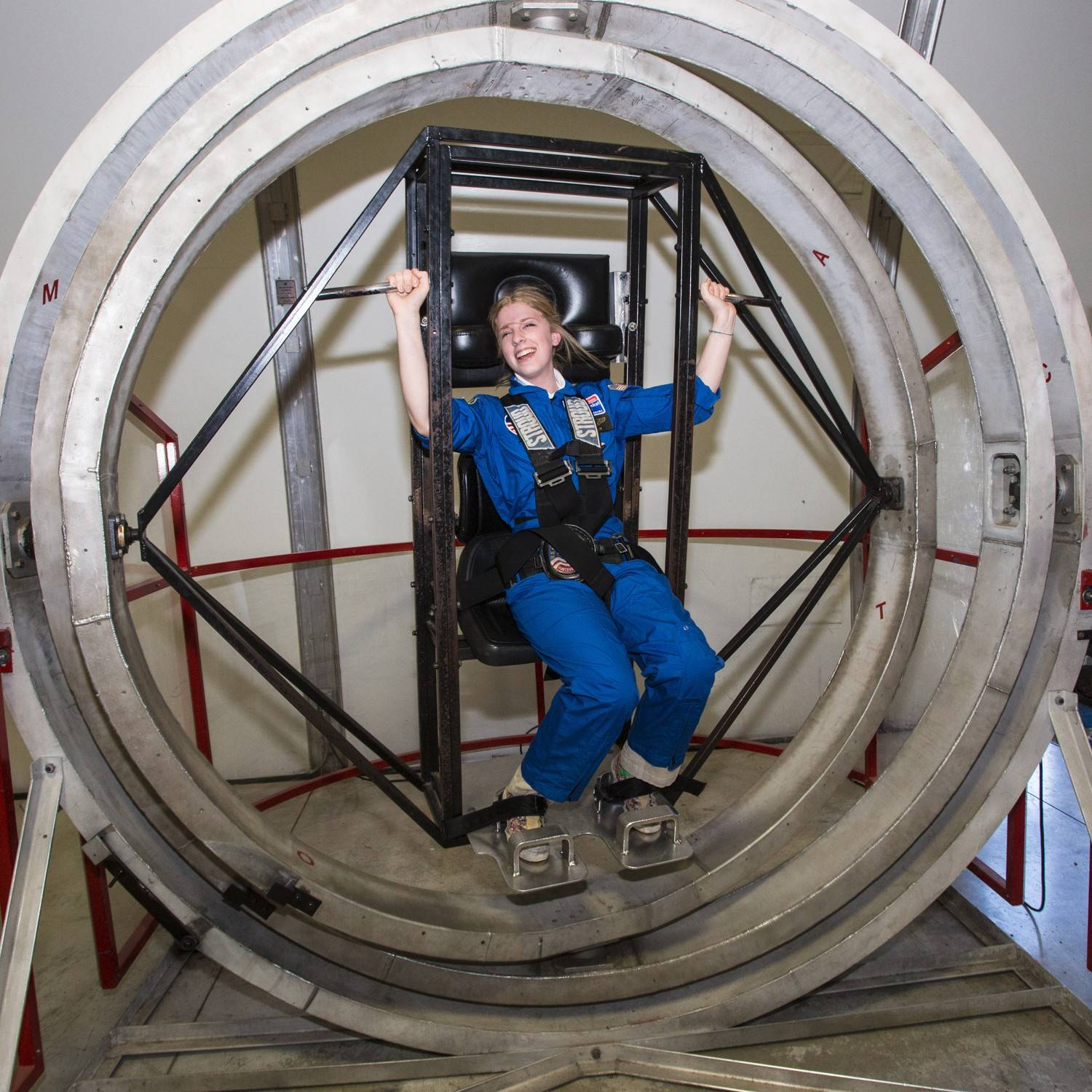 Angela Green of Glen Ellyn is in a Multi-Axis Trainer that simulates the disorientation one would feel in a tumble spin during re-entry into the Earth's atmosphere.
