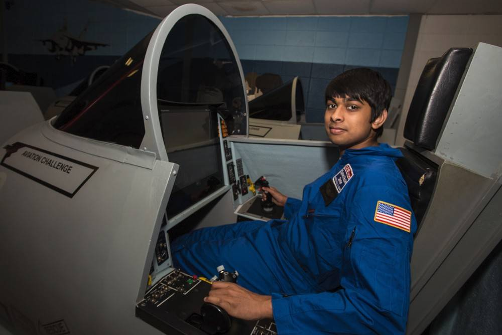 Rohit Anumakonda of Naperville is at the controls of a space shuttle simulator aviation program that reinforces leadership, teamwork and decision-making while building realistic piloting skills.