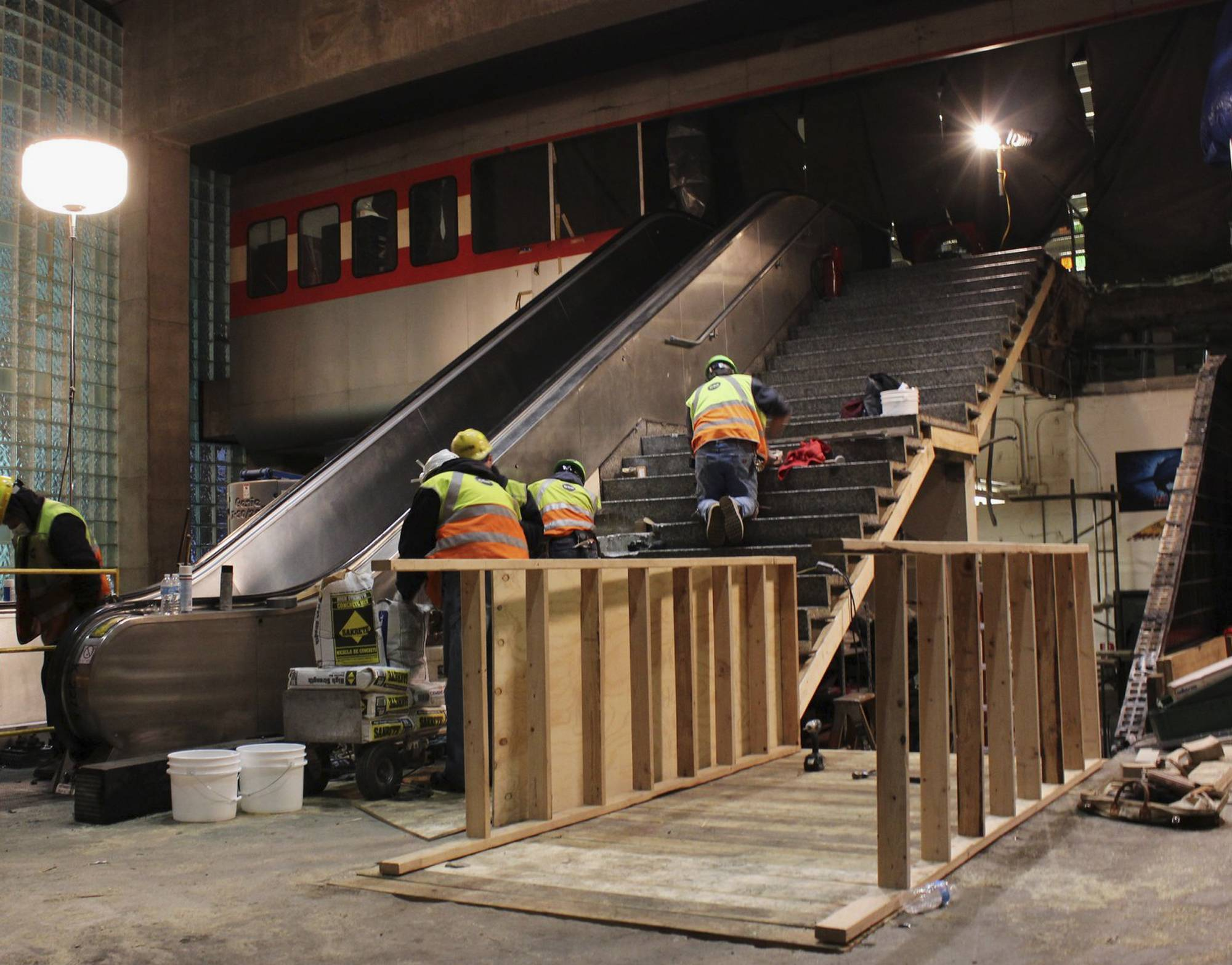 This photo provided by the Chicago Transit Authority shows workers on March 28 repairing the escalator and surrounding area where a CTA commuter train crashed at O'Hare International Airport on Monday injuring 32 passengers. Service to O'Hare was restored Sunday afternoon.