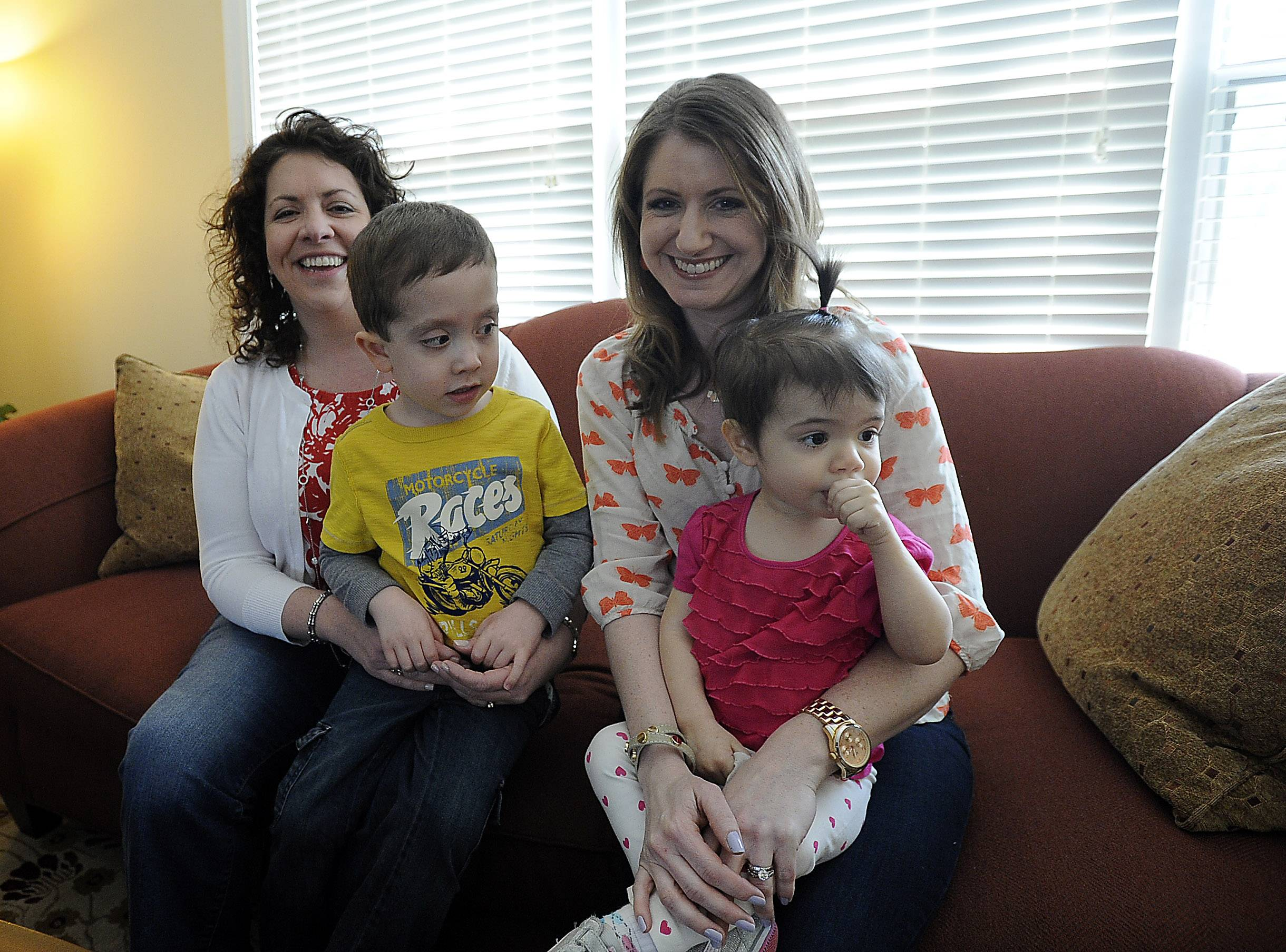 Jenn Licato of Arlington Heights, holding her 22-month-old daughter, Audrey, and Kristin Meek, with her son, Ben, 5, talking about their efforts to raise money for neurofibromatosis research.