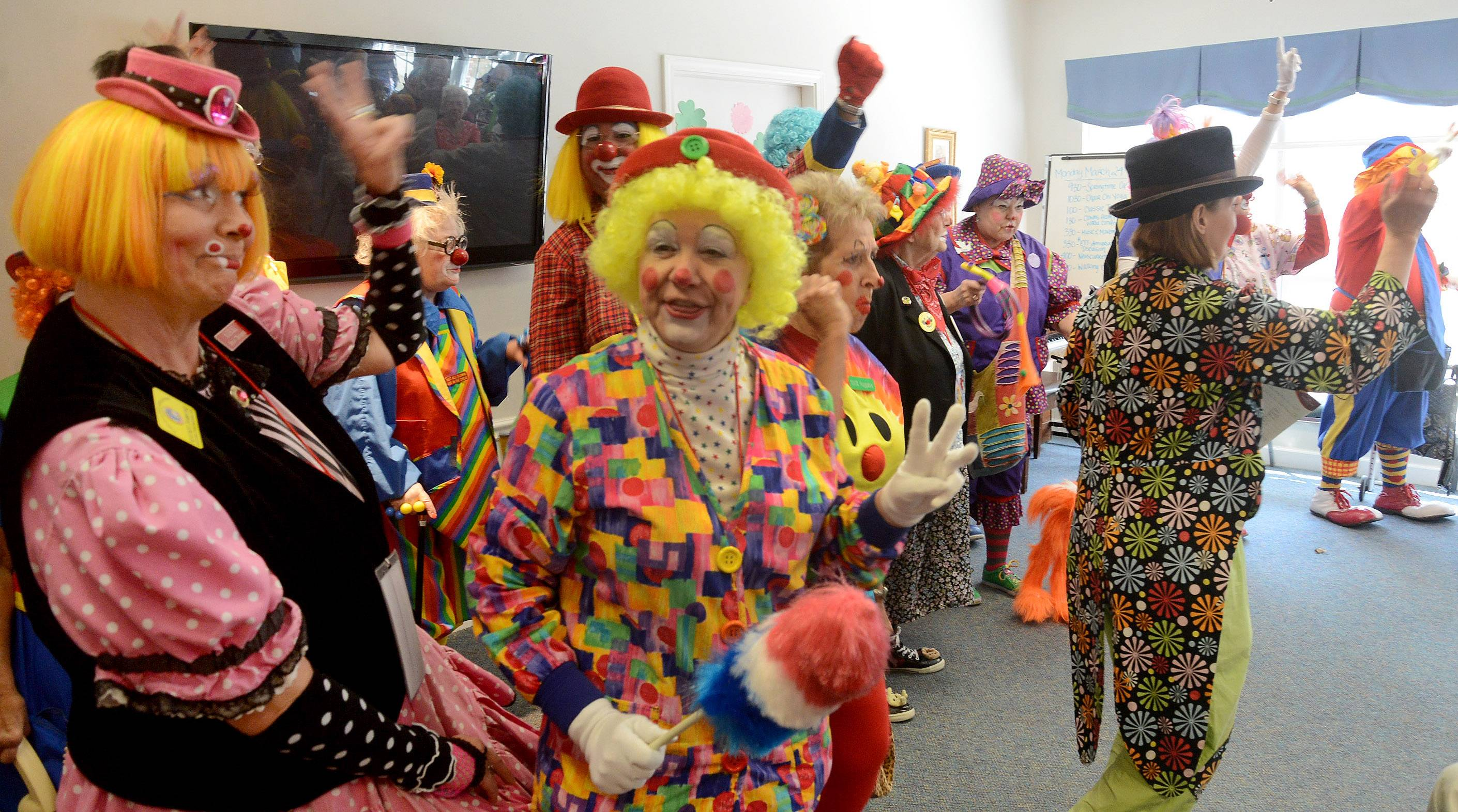 20 clowns in town for the World Clown Association's convention visited Alzheimer's patients Monday in the Arden Courts of Northbrook.