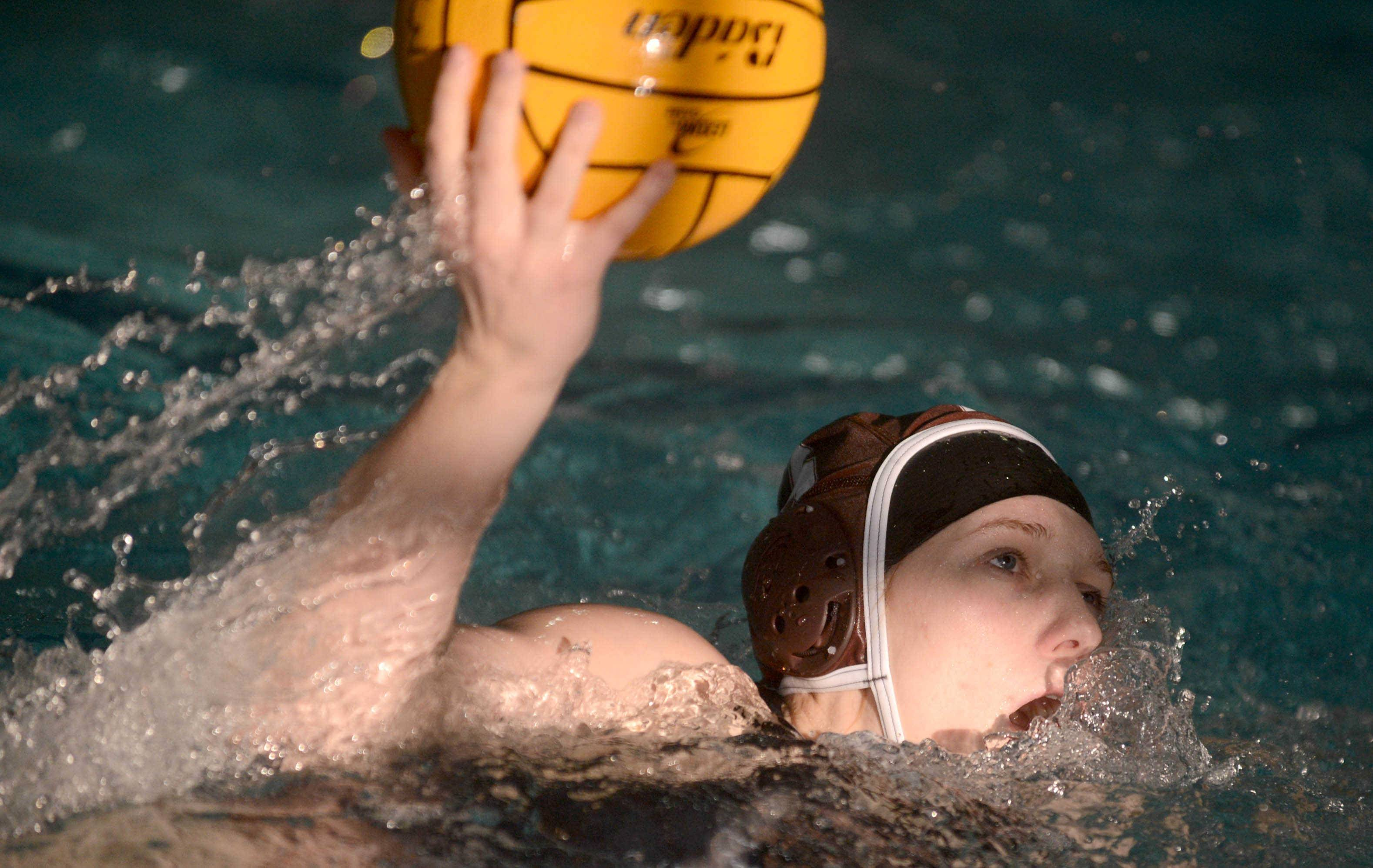 Hersey's Jill Hoffman advances the ball against Elk Grove during Monday's matchup at Olympic Pool in Arlington Heights.