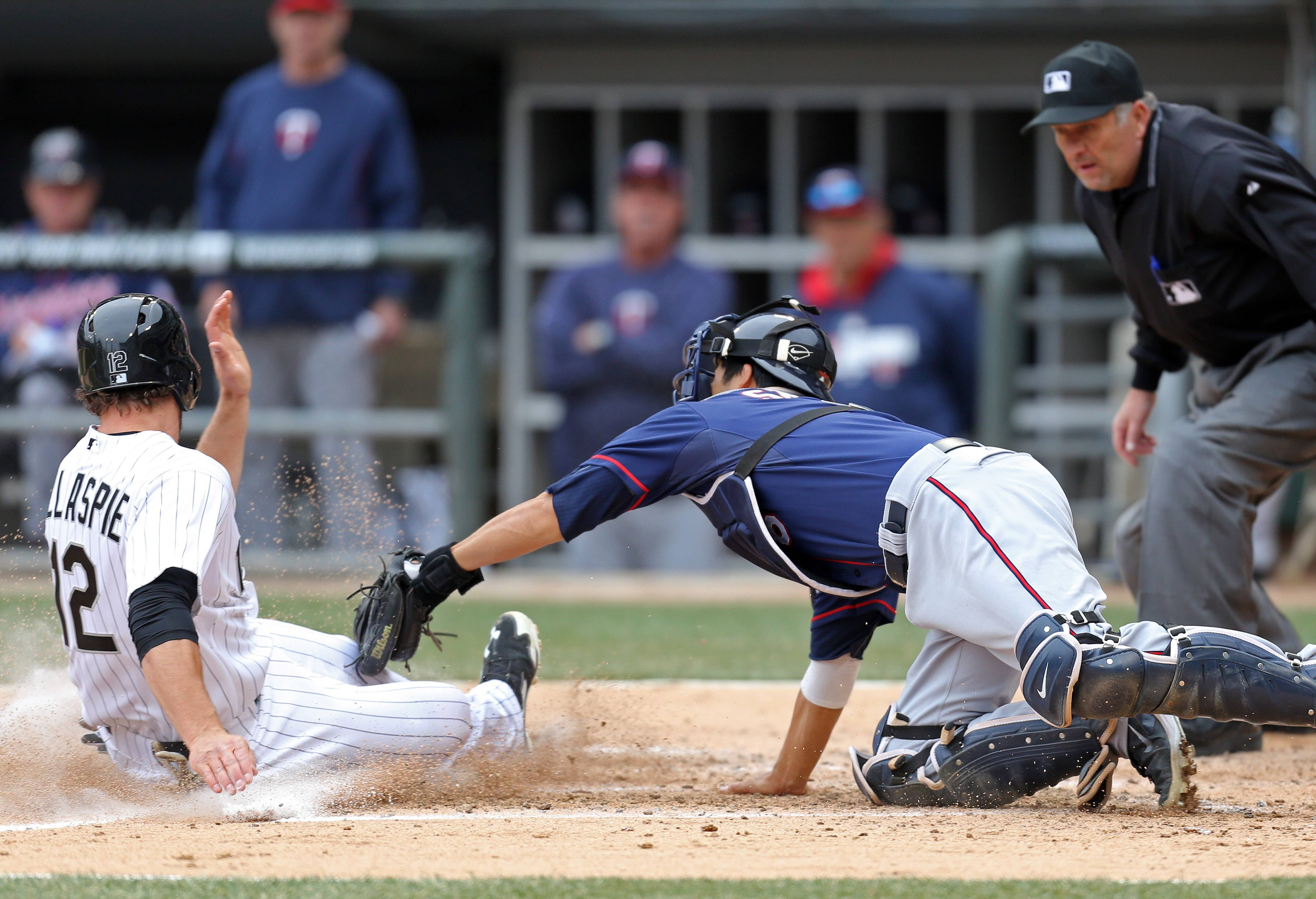 Conor Gillaspie scores on a play at home during the White Sox home opener against the Minnesota Twins Monday at U.S. Cellular Field.