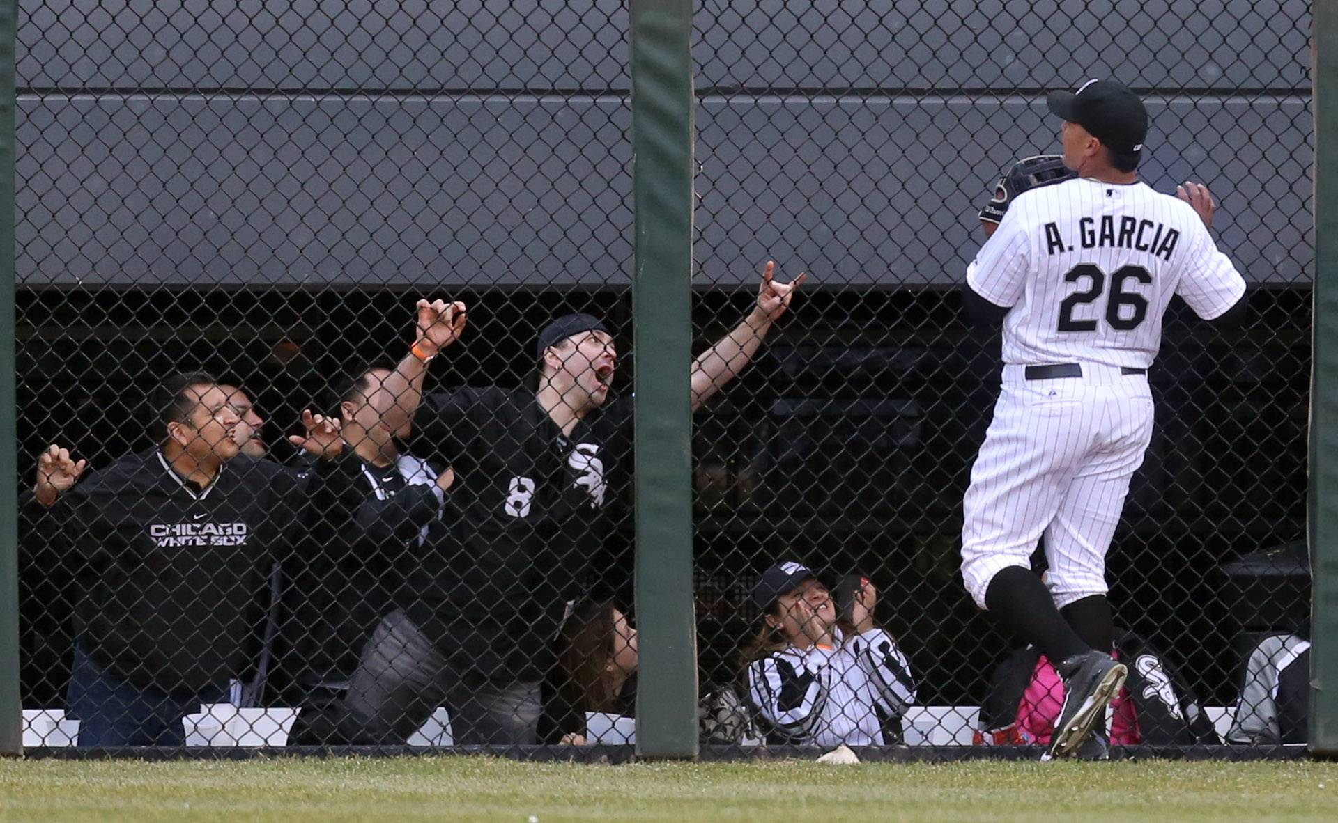 Fans in center field react as White Sox right fielder Avisail Garcia makes a catch late in the game during the home opener against the Minnesota Twins Monday at U.S. Cellular Field.