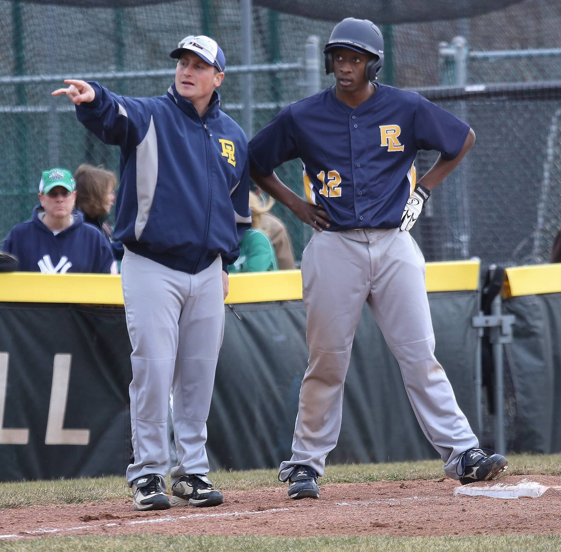 Round Lake coach Ed Adamson talks with Jalen Young at third base; Young had doubled earlier in the inning against host Grayslake Central on Monday.