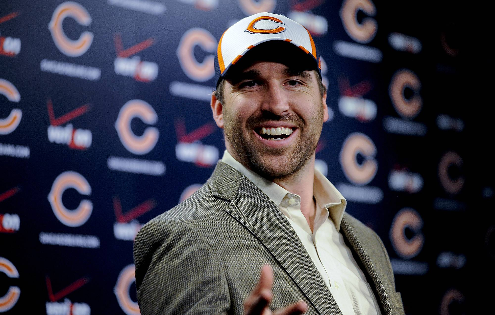 New Bear Jared Allen talks to the media at a news conference Monday in Lake Forest.