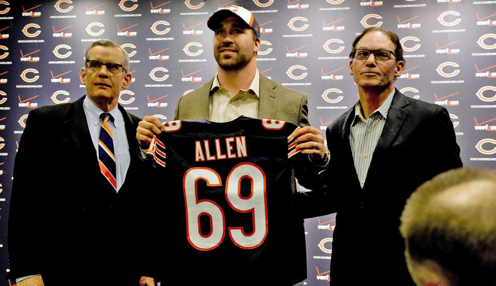 Chicago GM Phil Emery, left, poses for a photo with new Bear Jared Allen and his agent, Ken Harris, at a news conference Monday in Lake Forest.