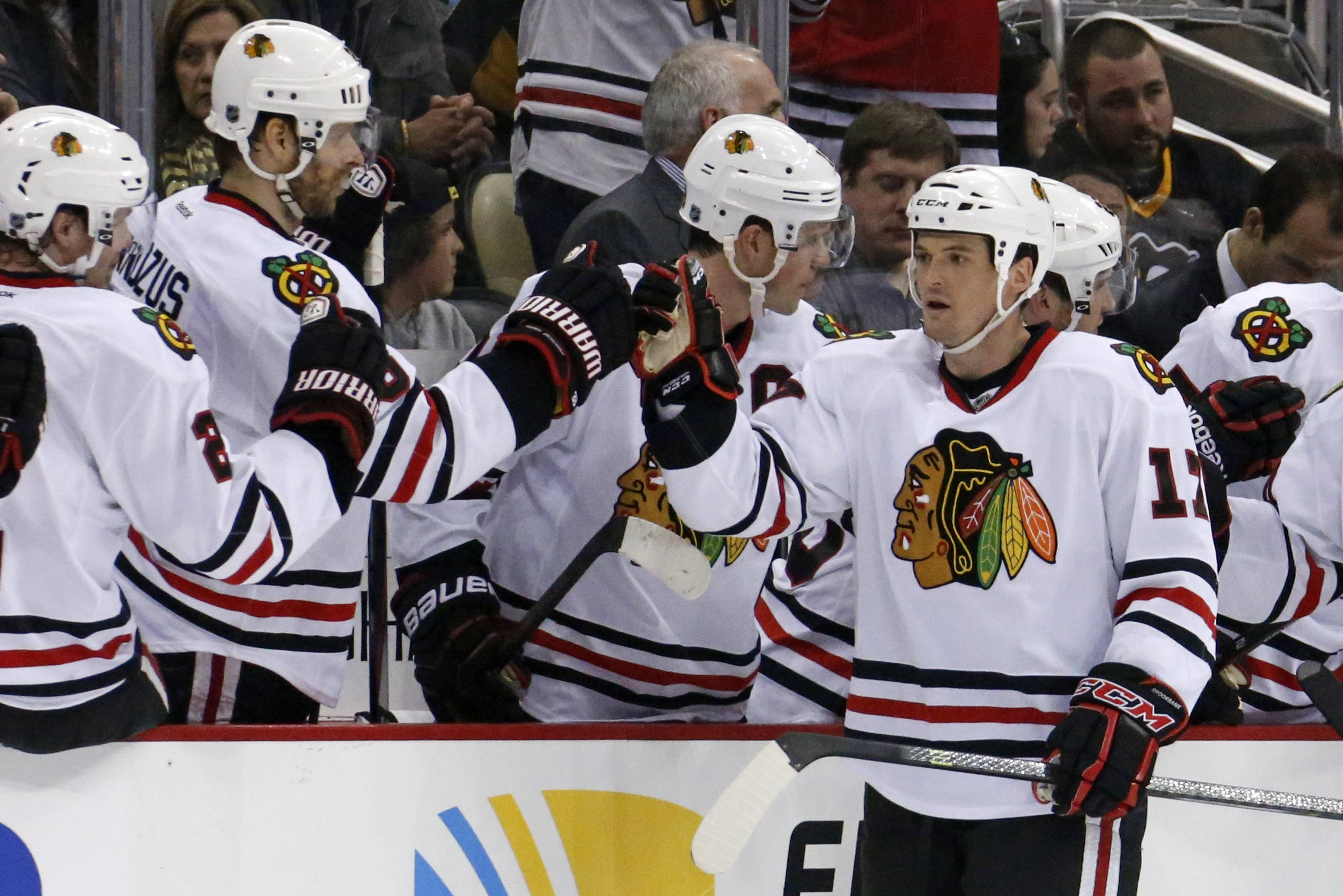 The Blackhawks' Sheldon Brookbank (17) celebrates with teammates as he returns to the bench after scoring in the second period of Sunday's game against the Pittsburgh Penguins in Pittsburgh,