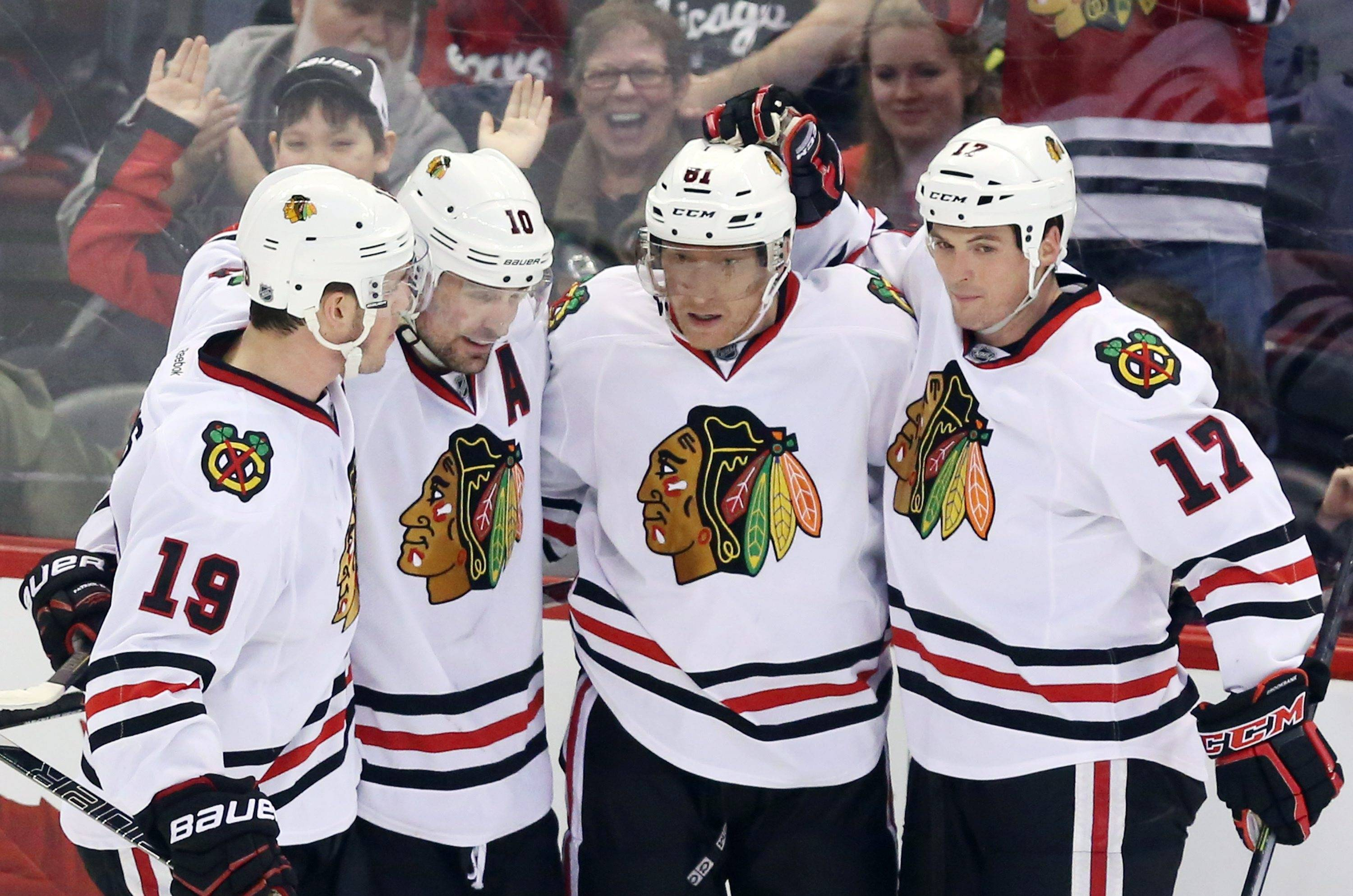 The Blackhawks' Marian Hossa (81) celebrates his goal with teammates Jonathan Toews (19), Patrick Sharp (10) and Sheldon Brookbank (17) during second-period action Friday against the Ottawa Senators in Ottawa, Ontario.