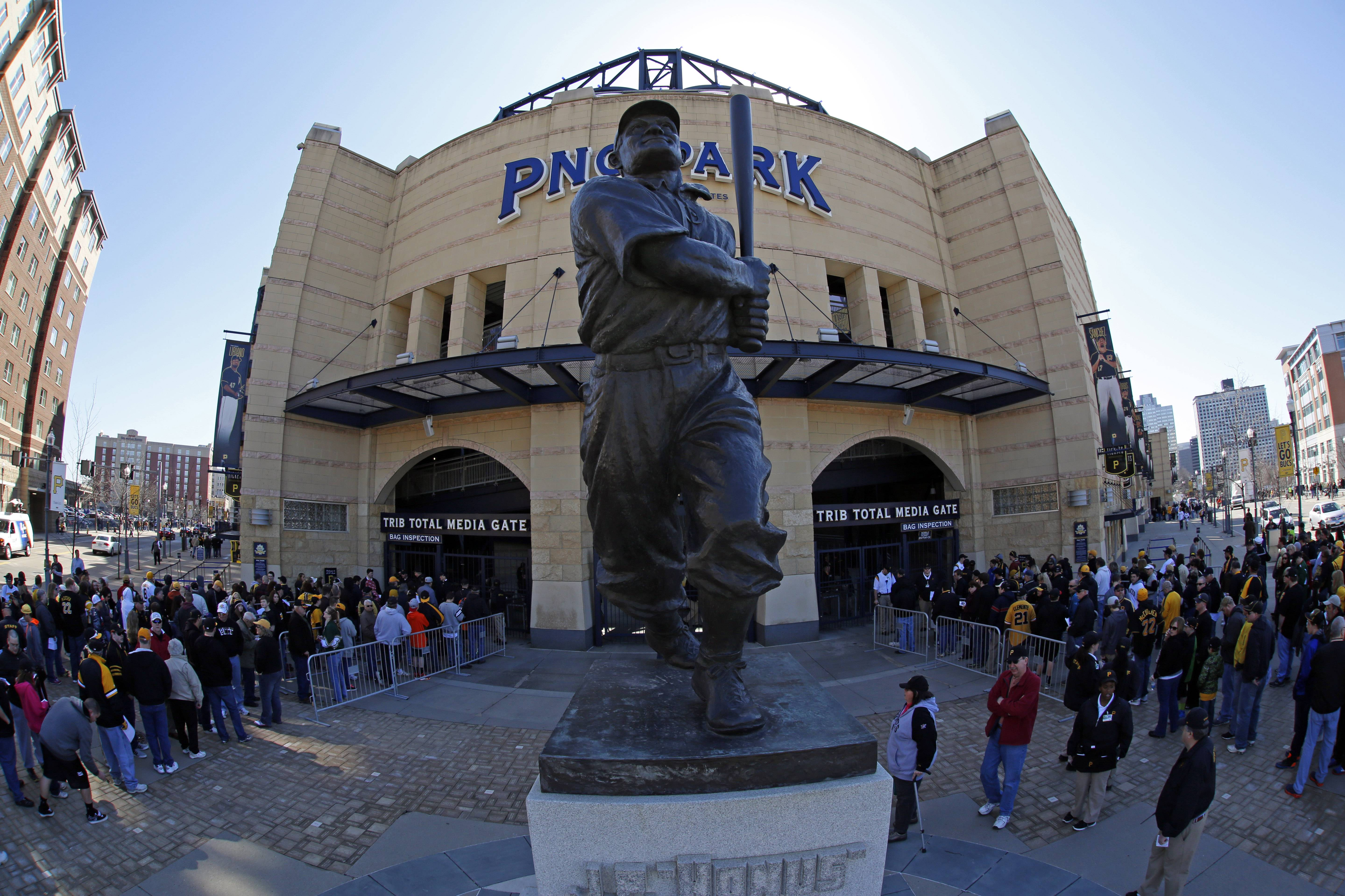 Baseball fans line up outside PNC Park near the statue of Hall of Fame Pittsburgh Pirates shortstop Honus Wagner.