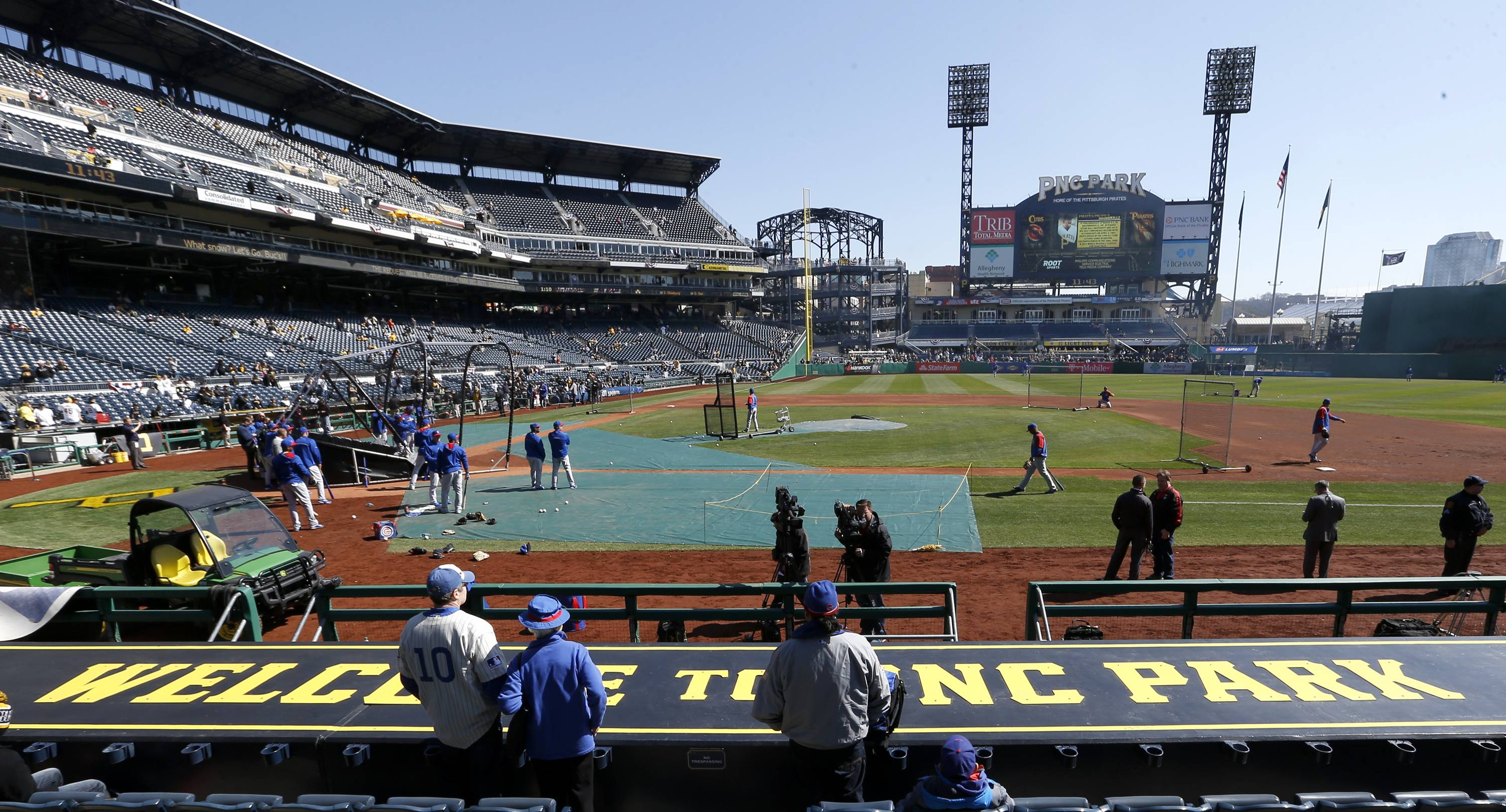 Chicago Cubs fans stand behind the first base dugout at PNC Park in Pittsburgh as their team takes batting practice.