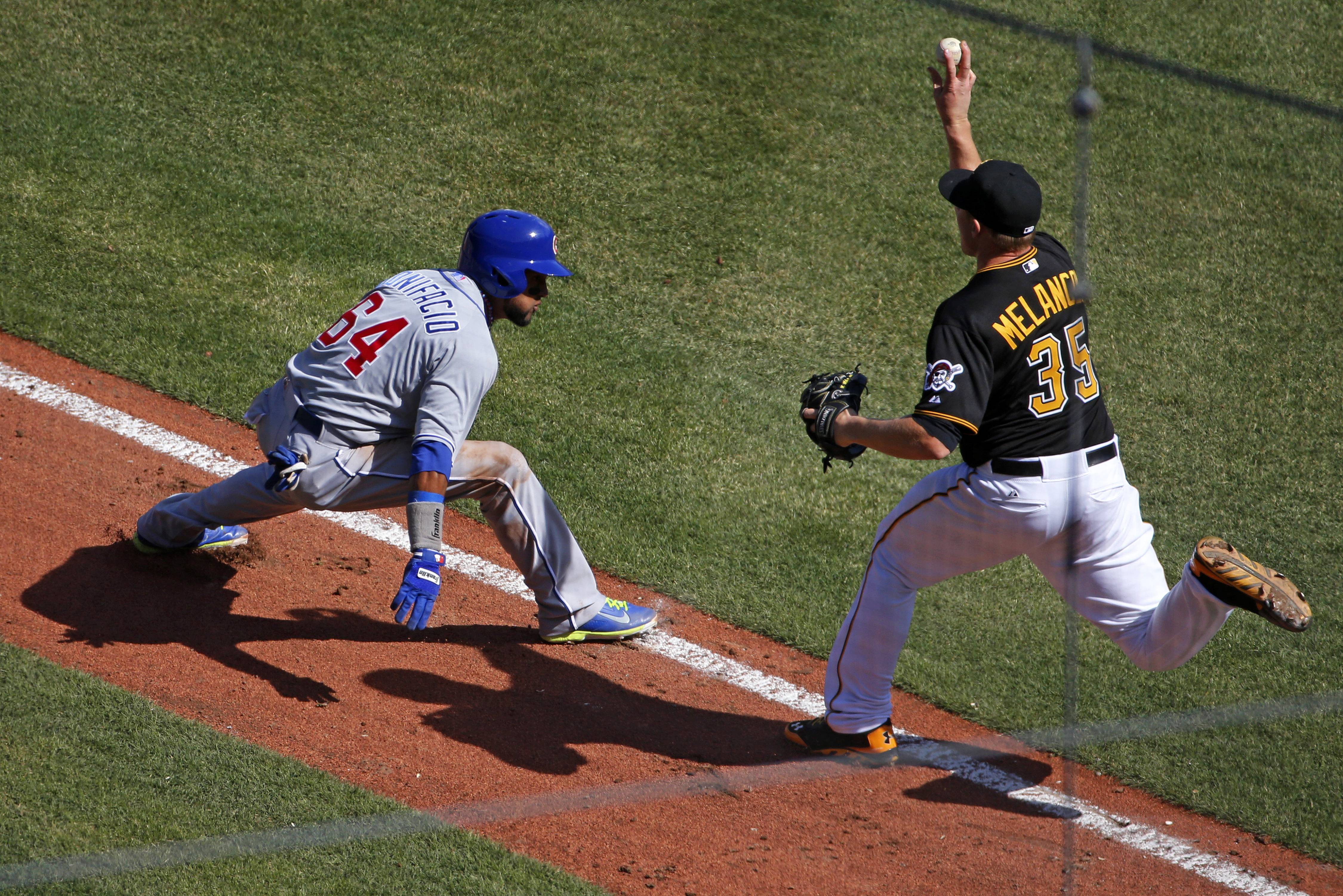 Chicago Cubs' Emilio Bonifacio (64) is caught in a rundown between third and home by Pittsburgh Pirates relief pitcher Mark Melancon (35) during the eighth inning.