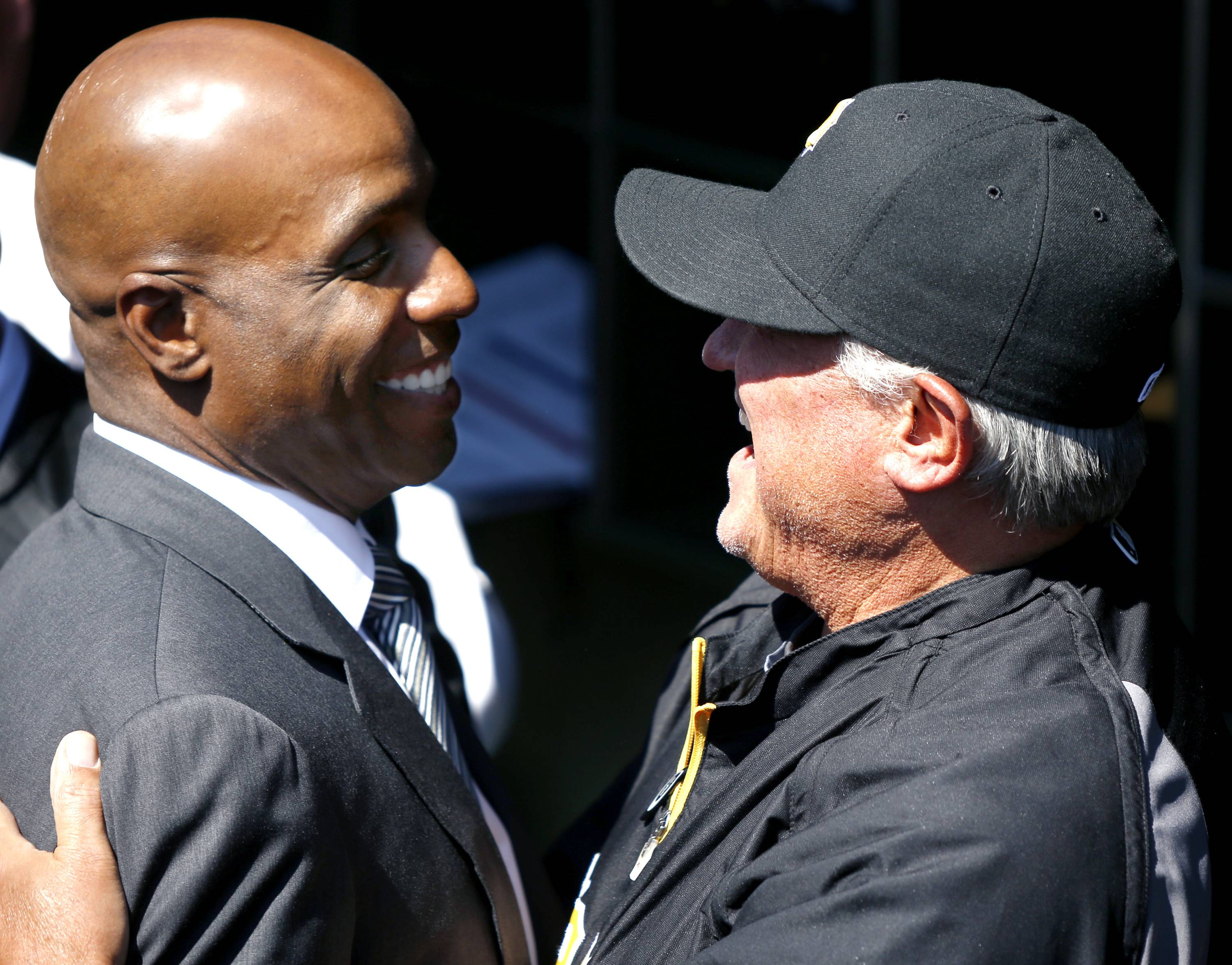 Former Pittsburgh Pirates outfielder Barry Bonds, left is greeted by current manager Clint Hurdle.