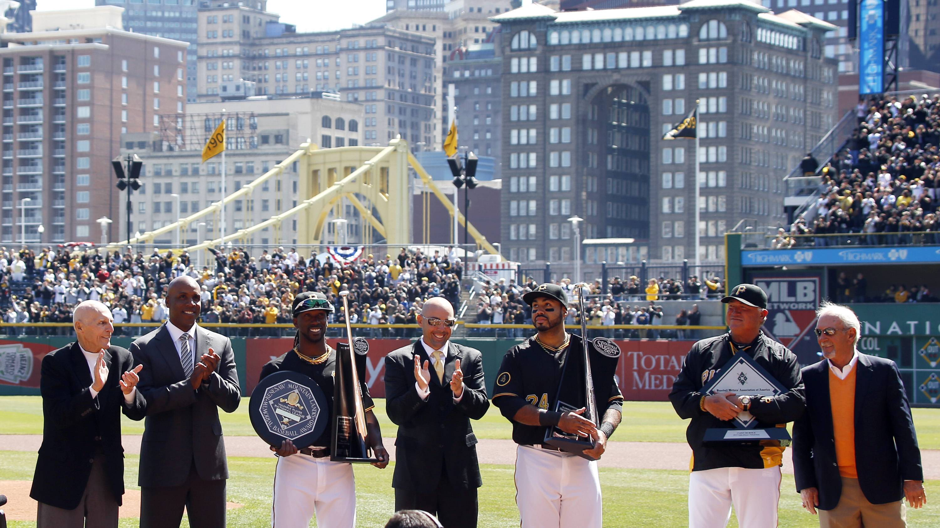 Former Pittsburgh Pirates Dick Groat, left, Barry Bonds, second from left, Jack Wilson, center, present awards to Pittsburgh Pirates Andrew McCutchen, third from left, and Pedro Alvarez, third from right, with manager Clint Hurdle, second from right, and former Pirates manager Jim Leyland. McCutchen was presented with the NL League MVP and Silver Slugger Award and Alvarez a Silver Slugger Award.