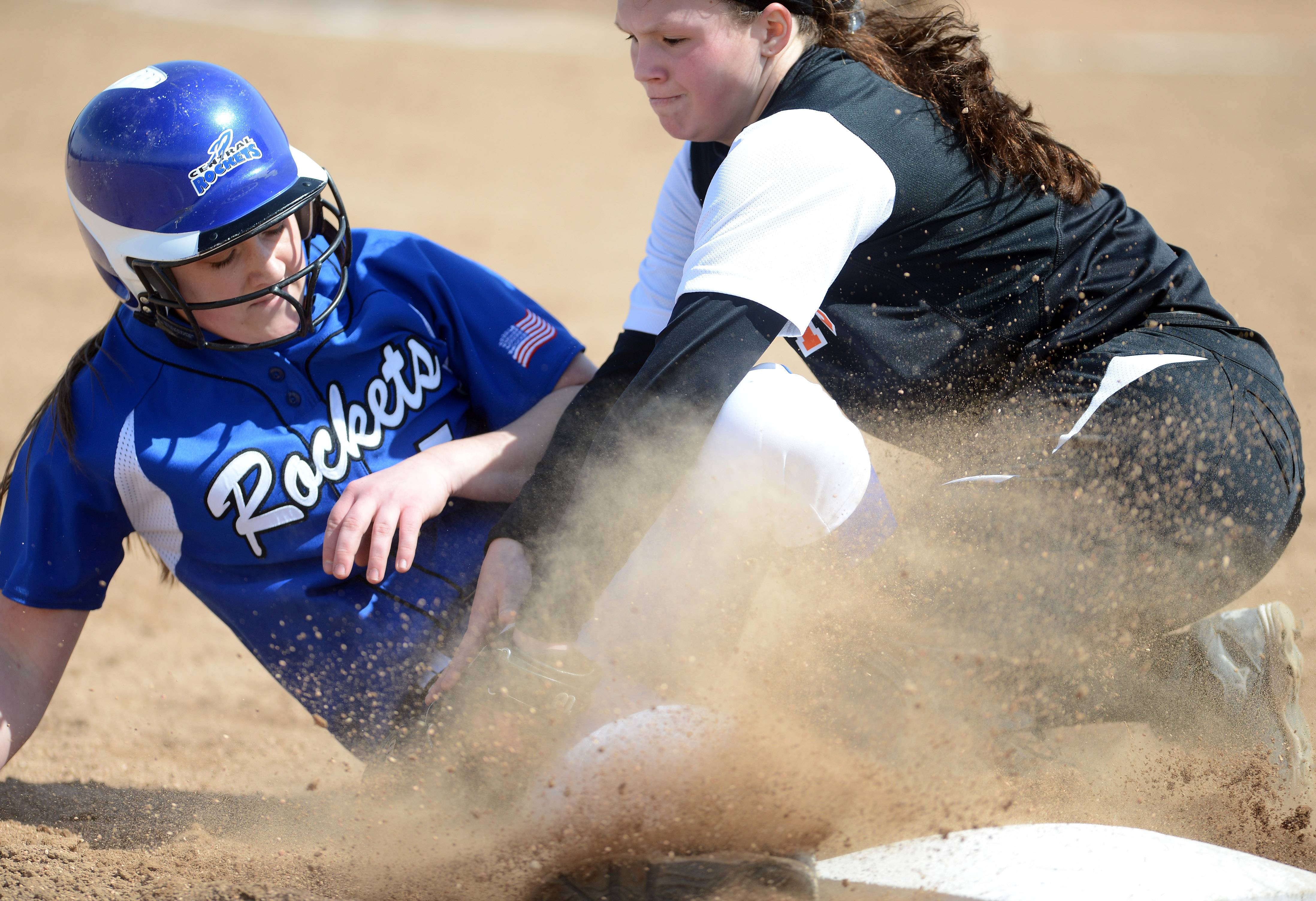 St. Charles East's Alex Latoria tags out Burlington Central's Bekah Harnish at third during Monday's game in St. Charles.