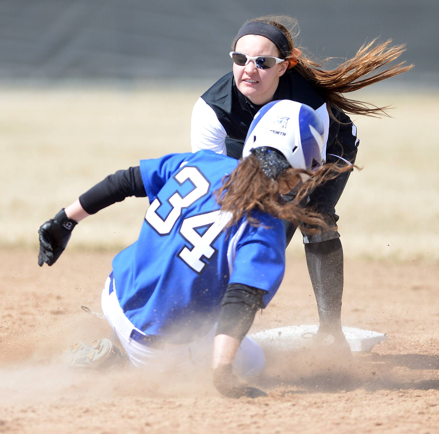 St. Charles East's Tess Hupe tags out Burlington Central's Shelby Young at second during Monday's game in St. Charles.