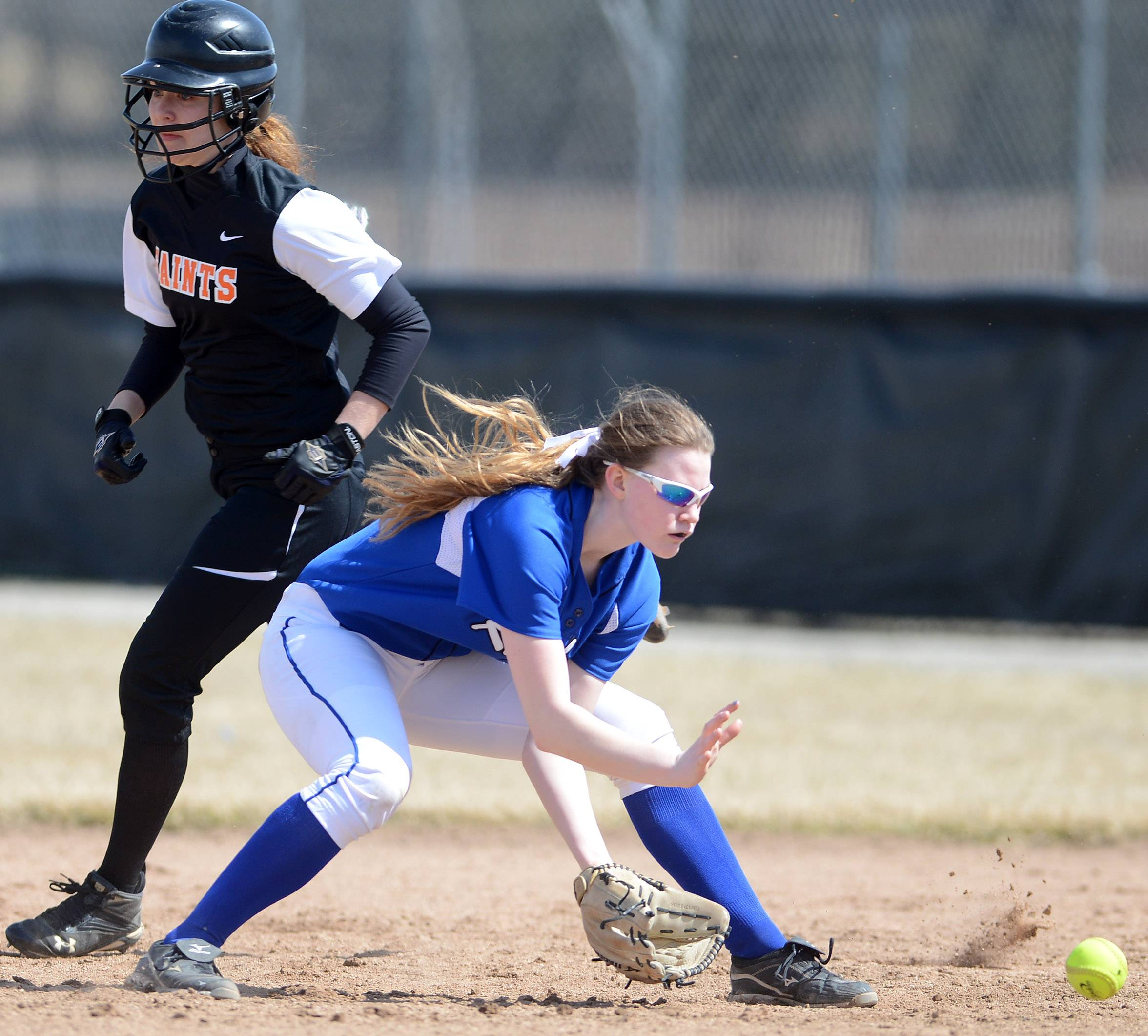 Burlington Central's Rebecca Gerke fields a grounder at second against St. Charles East during Monday's game in St. Charles.