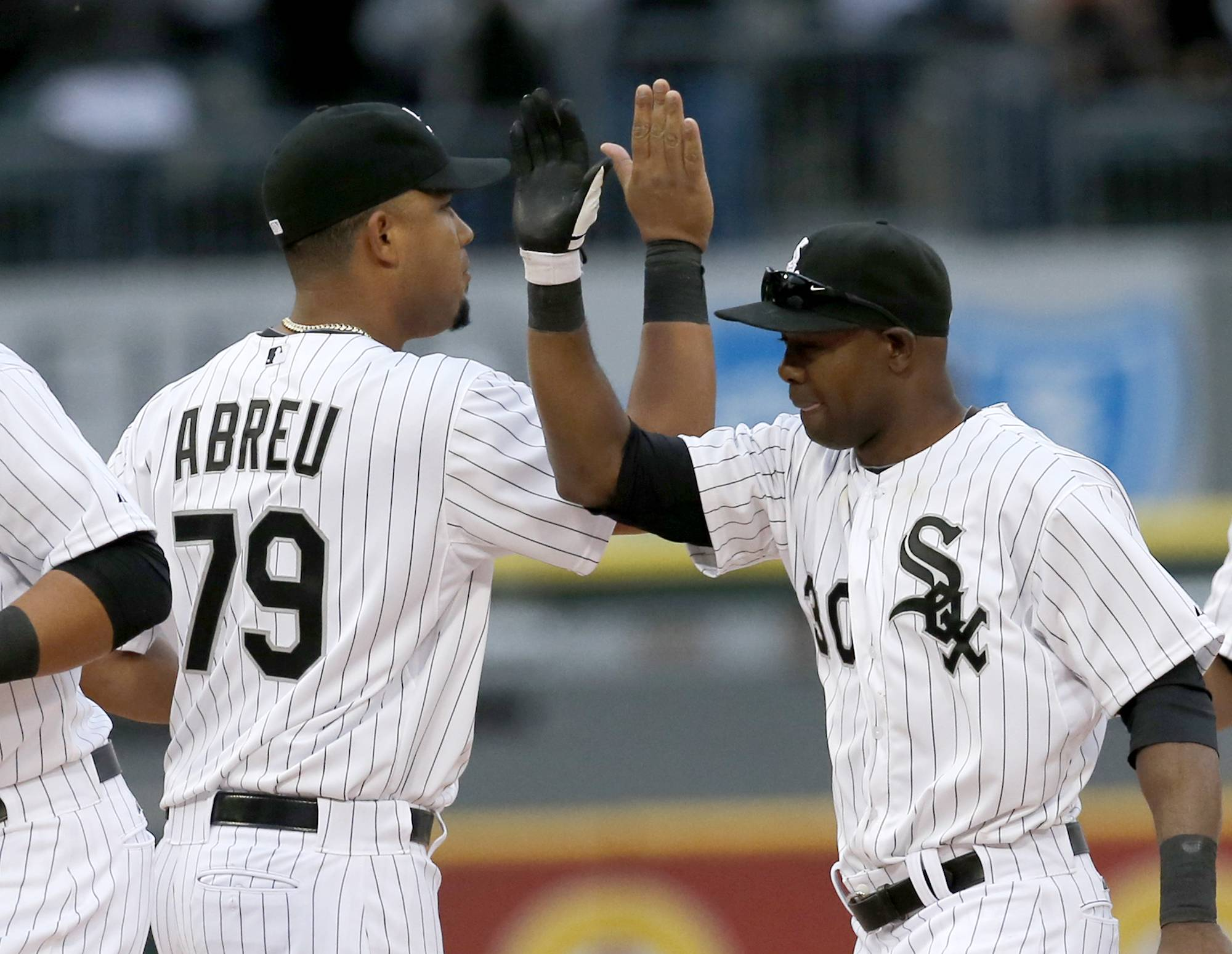 Jose Abreu and Alejandro De Aza celebrate a 5-3 win over the Minnesota Twins on Opening Day in Chicago.