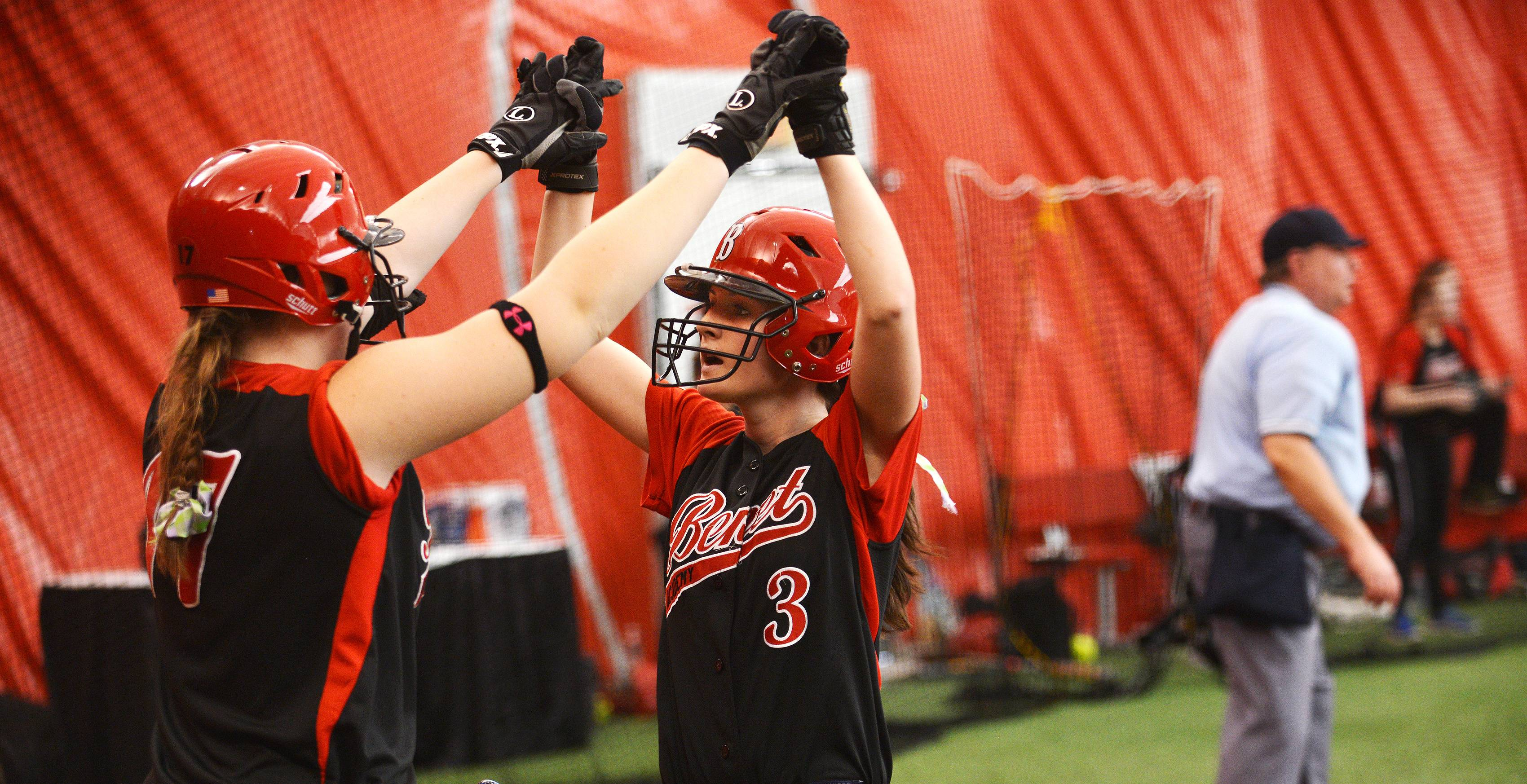 Benet played Neuqua Valley Monday, March 31 in indoor softball action in Rosemont. Benet's Emily York, left, high fives Shannon Mills in the second inning after she scored.