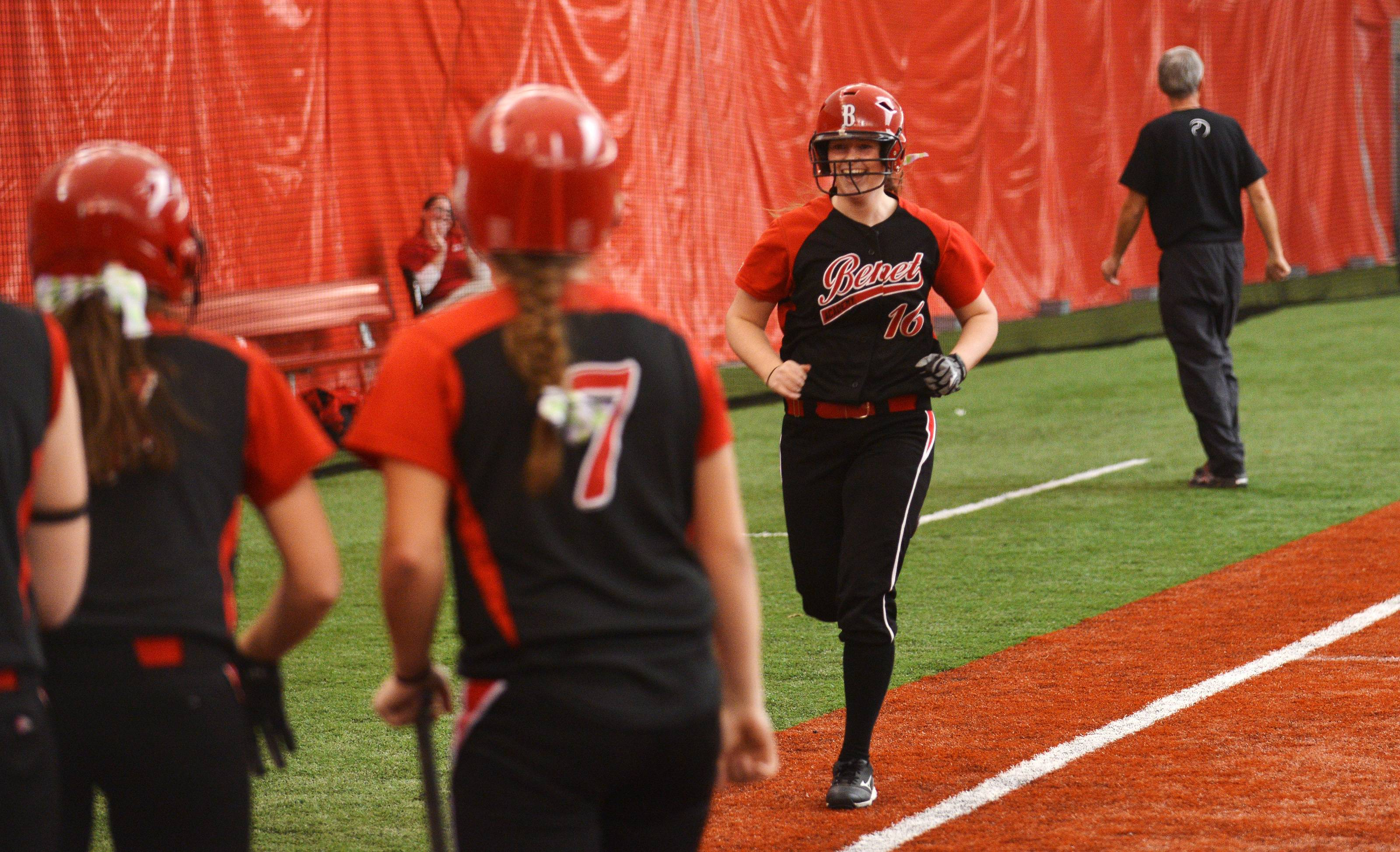 Benet played Neuqua Valley Monday, March 31 in indoor softball action in Rosemont. Benet's Julianne Rurka is all smiles as she trots to home after hitting a two-run homer to left field in the bottom of the 4th inning. That put Benet up by 1 run.