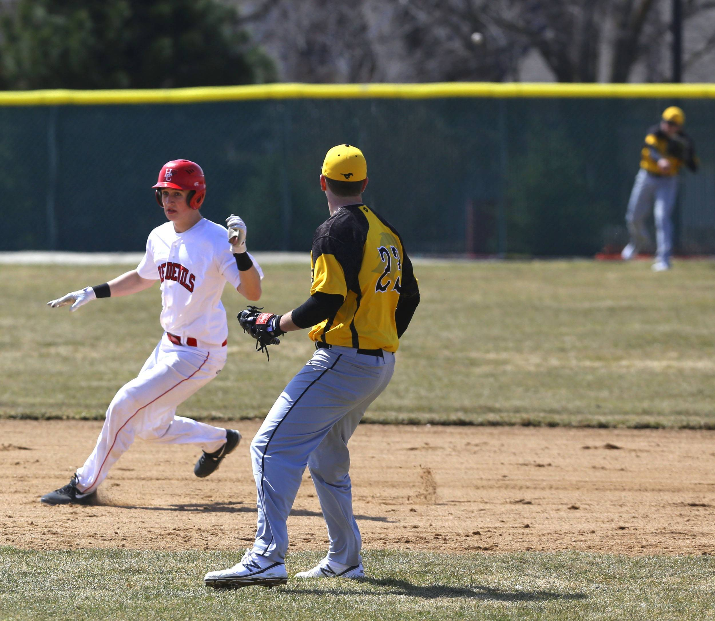 Hinsdale Central's Matt Muellner looks to his third base coach after doubling home the eventual game winning runs during a 7-4 home opener win over Metea Valley.