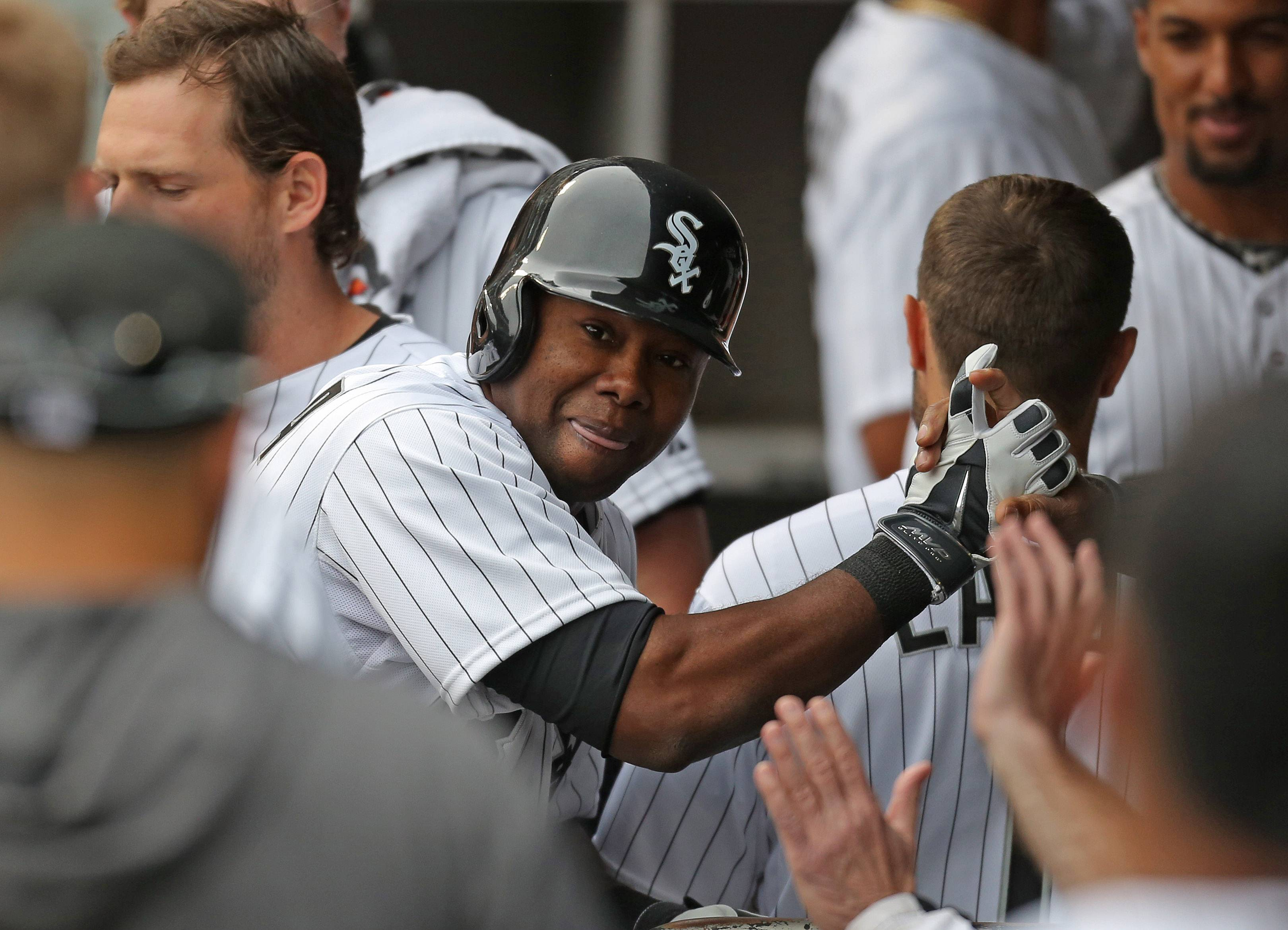 Chicago White Sox center fielder Alejandro De Aza high fives teammates on the bench after his second homer of the game.
