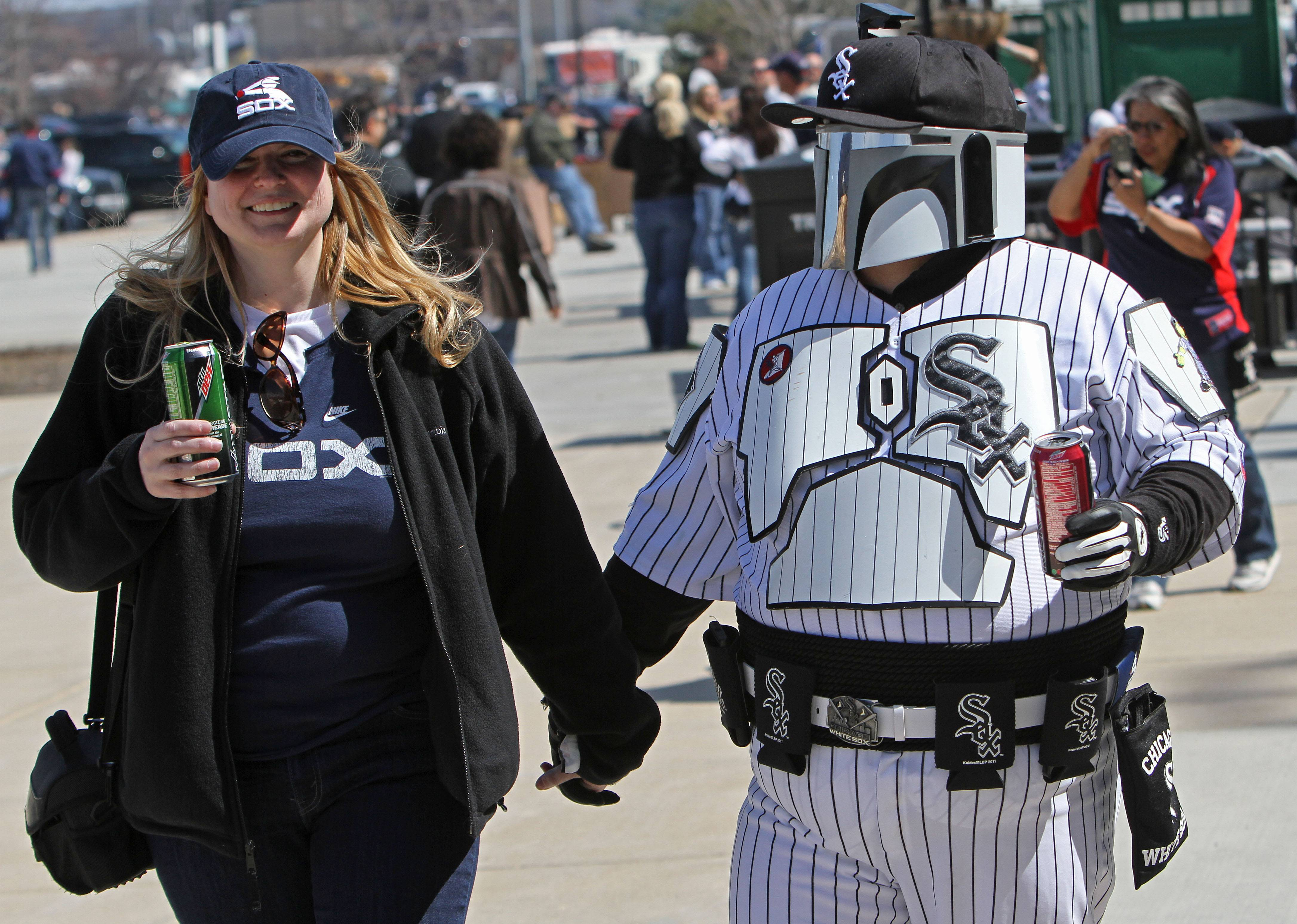 Lisa and Sean Hynes of Naperville walk outside U.S. Cellular Field before the game. Sean's outfit is a cross between Boba Fett of Star Wars and Carlton Fisk.