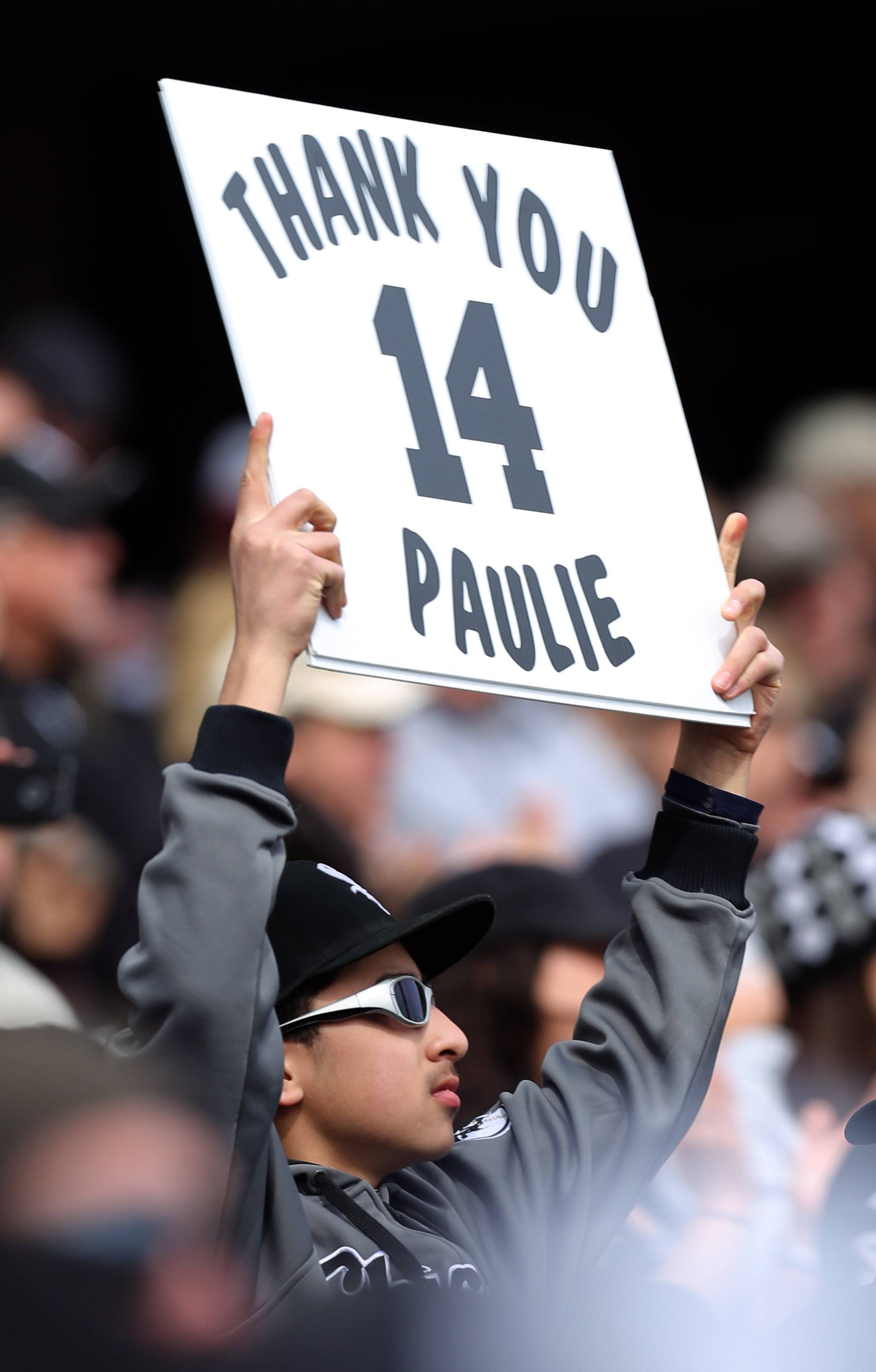 A fan holds a sign thanking longtime White Sox Paul Konerko.