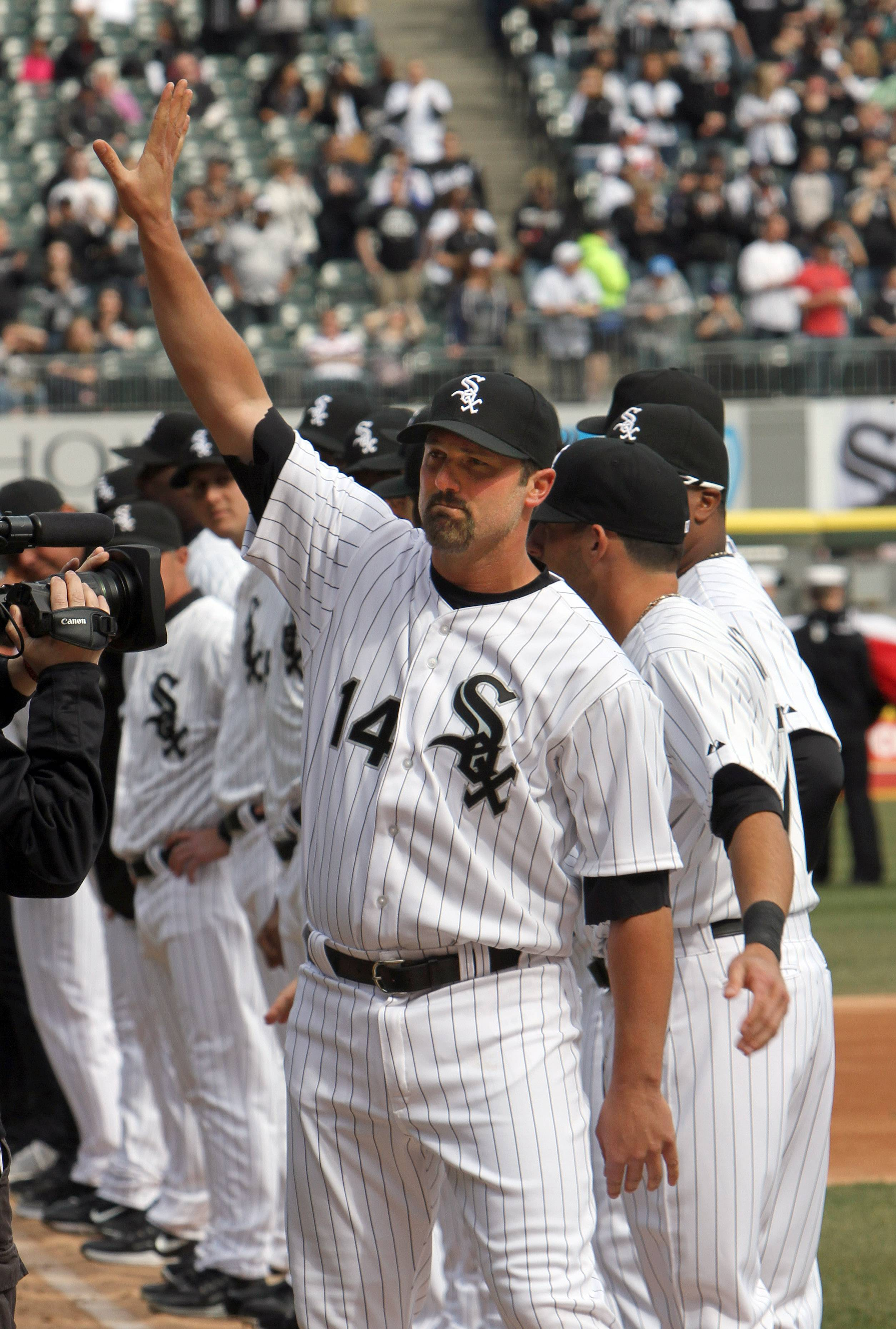 Chicago White Sox first baseman Paul Konerko waves to the crowd during player introductions.