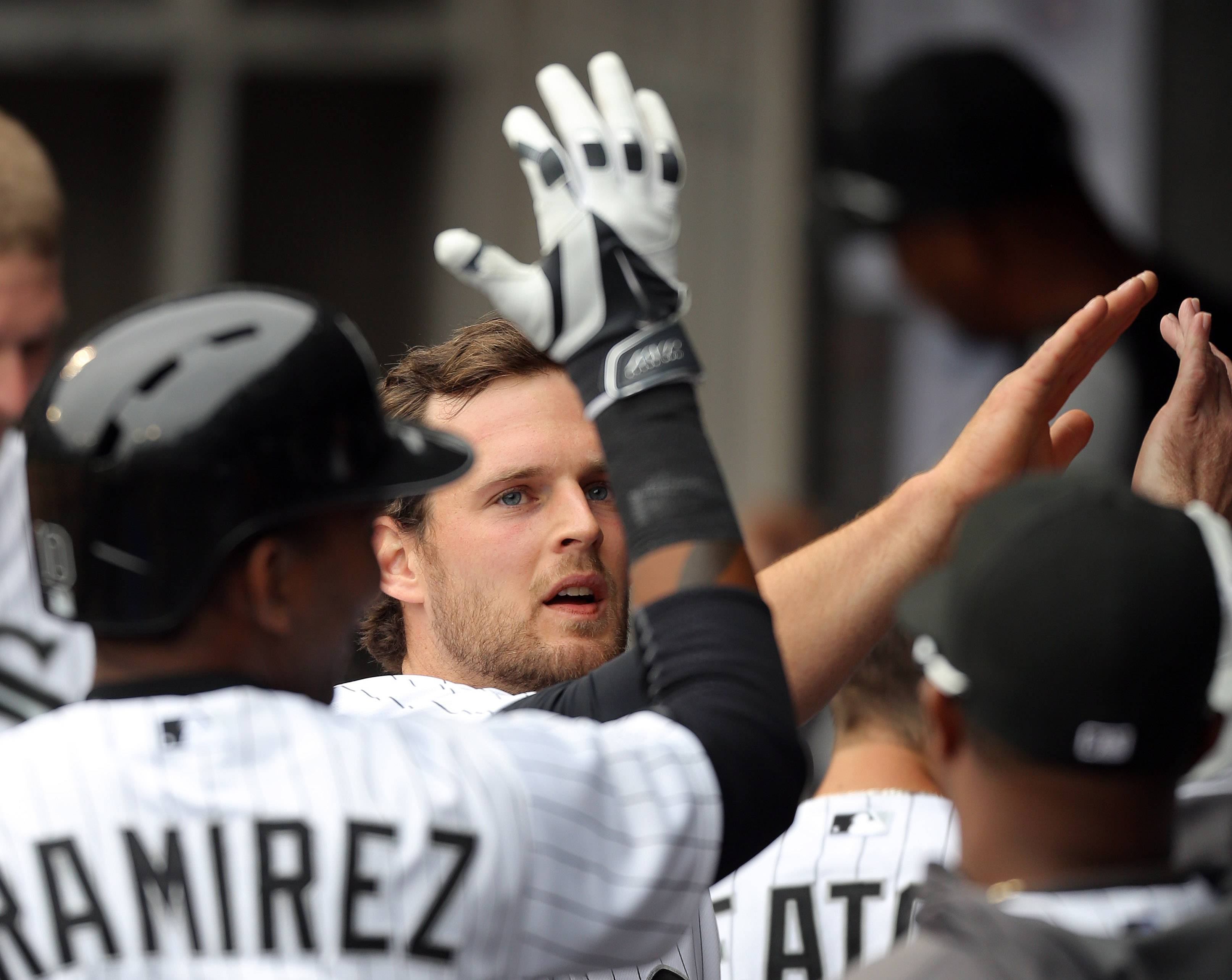 Chicago White Sox third baseman Conor Gillaspie gets high fives after  scoring.