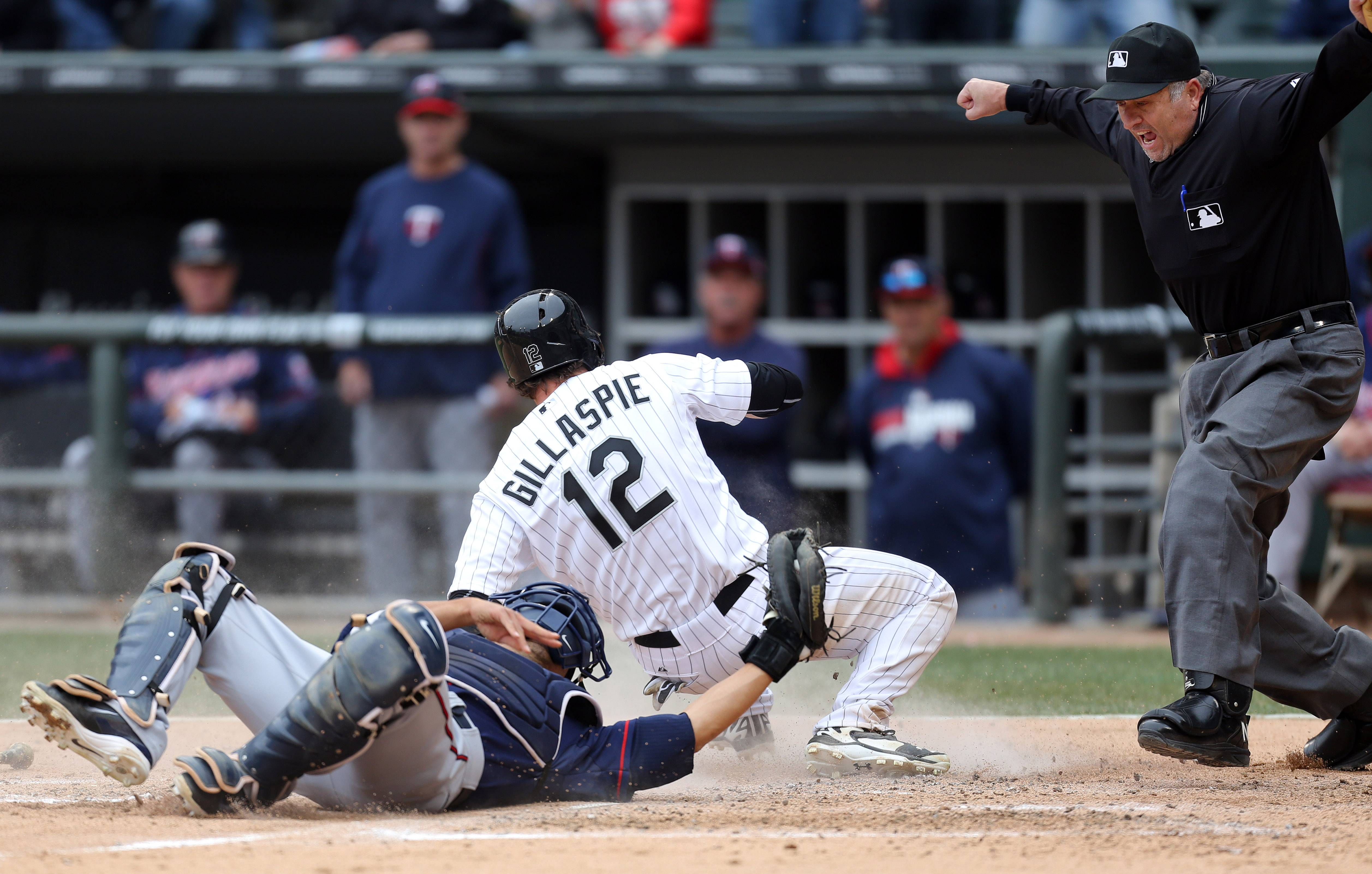 Chicago White Sox third baseman Conor Gillaspie scores on a play at home.