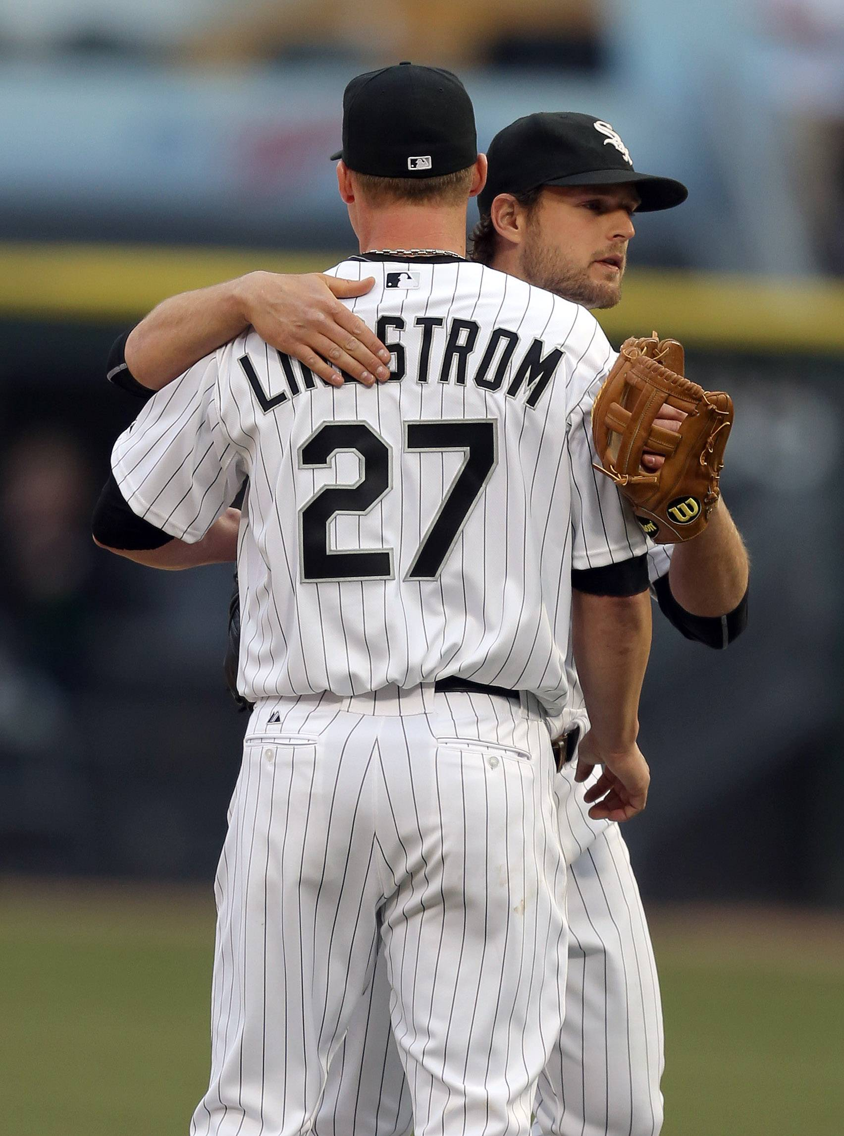 Chicago White Sox third baseman Conor Gillaspie, right, hugs Chicago White Sox relief pitcher Matt Lindstrom after the game.