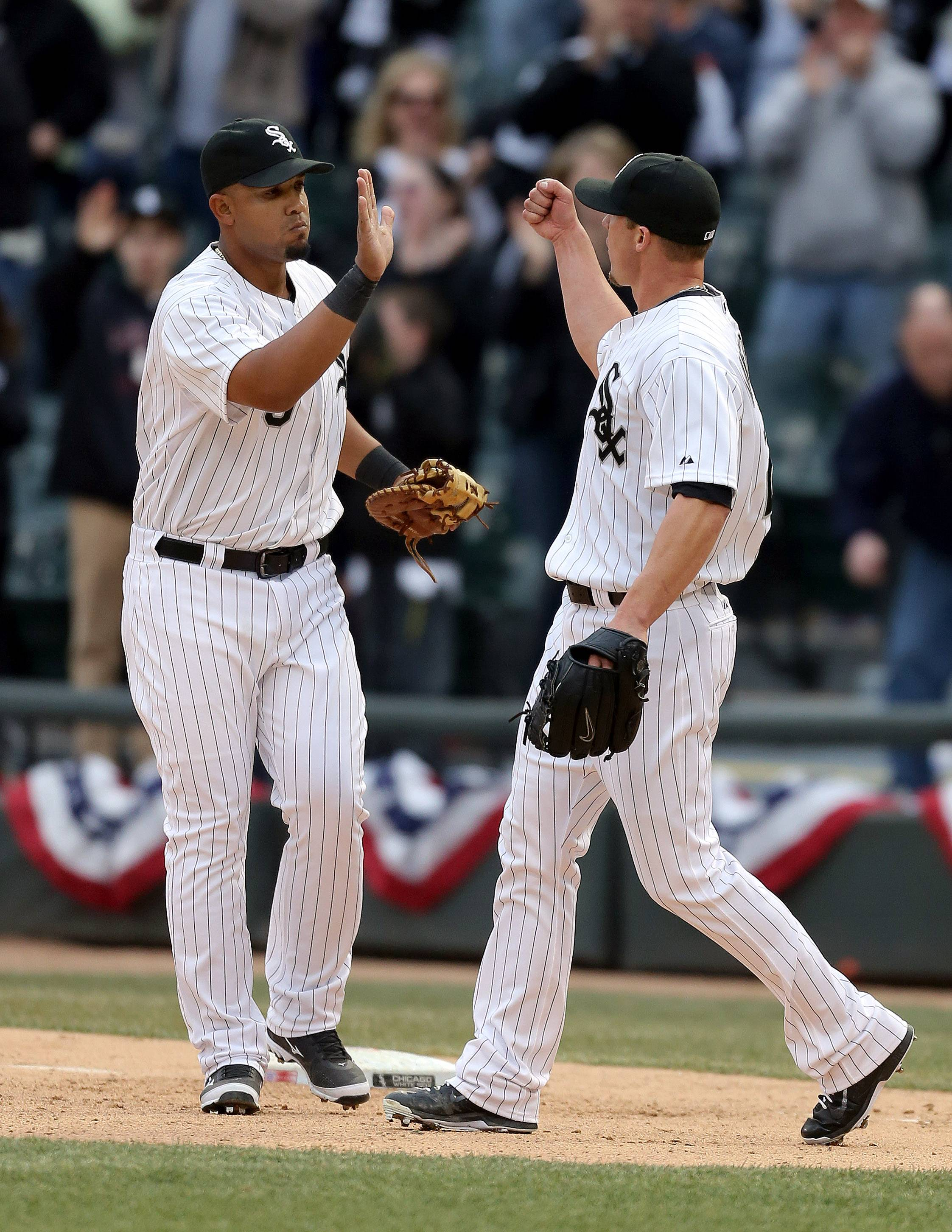 Chicago White Sox first baseman Jose Abreu high-fives relief pitcher Matt Lindstrom after the game.
