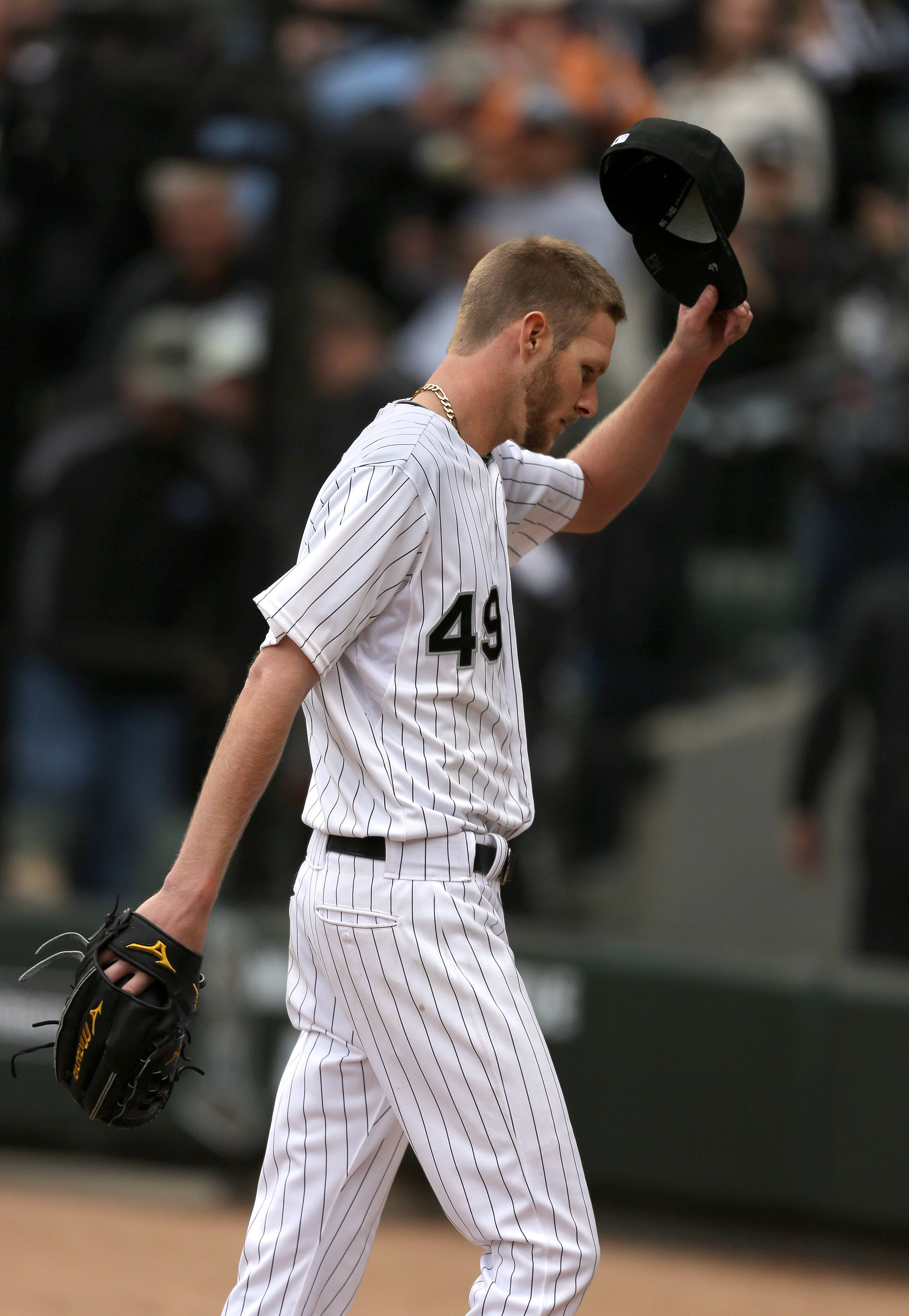 Chicago White Sox starting pitcher Chris Sale tips his cap after coming out of the game in the eighth inning.