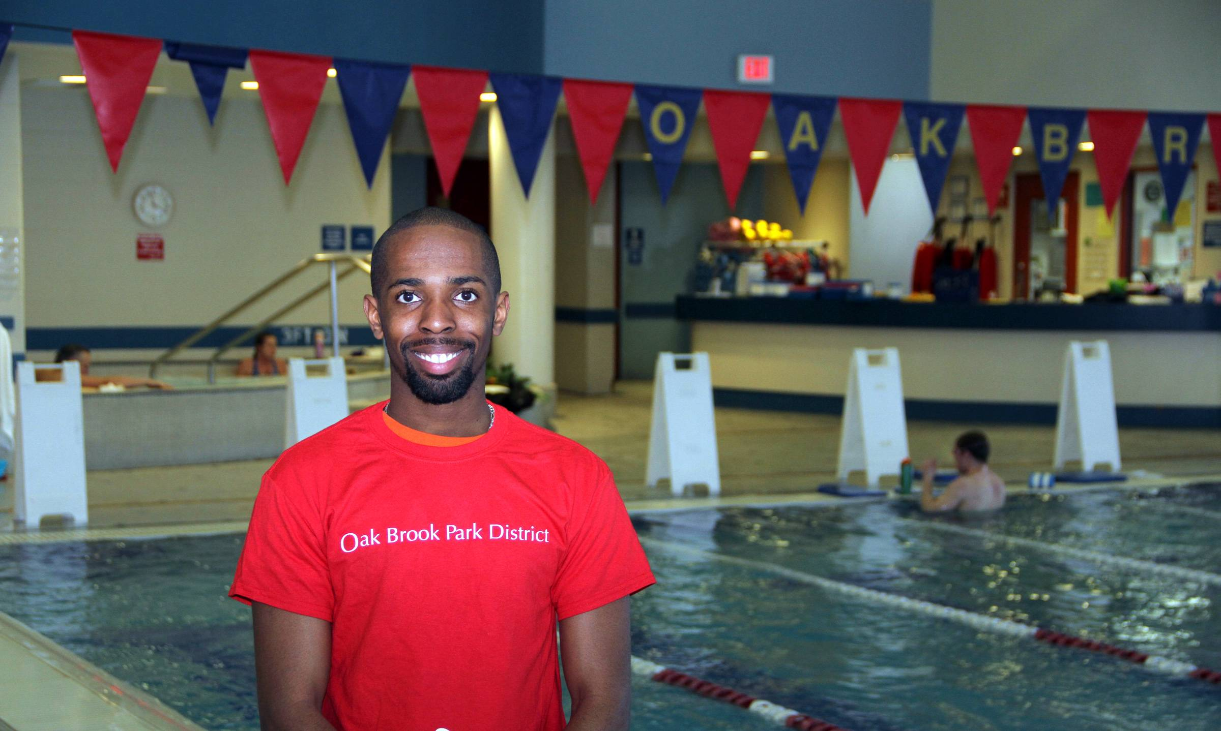One in One Thousand:  Darius Melton, 23, of Chicago and a lifeguard at the Oak Brook Park District Family Aquatic Center, was the recent recipient of the National Golden Guard Award from Ellis and Associates, Inc. Only one in one thousand lifeguards across the nation will ever receive this award. Greg Wooley, Oak Brook Park District