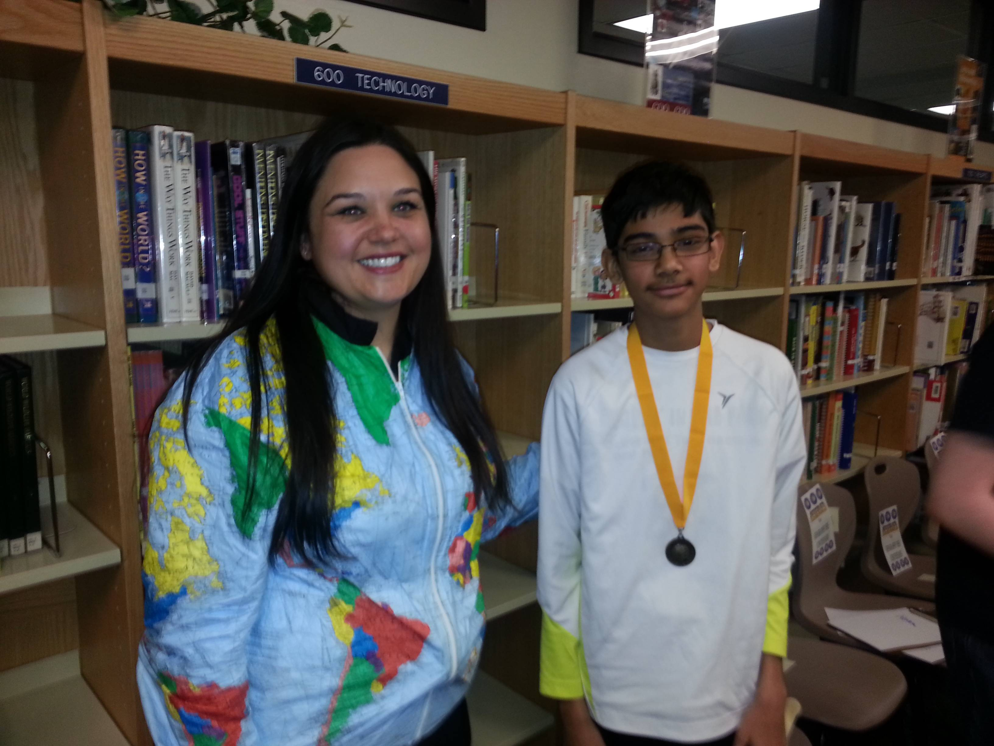 Shaan Thakkar winning medal at local Geography Bee