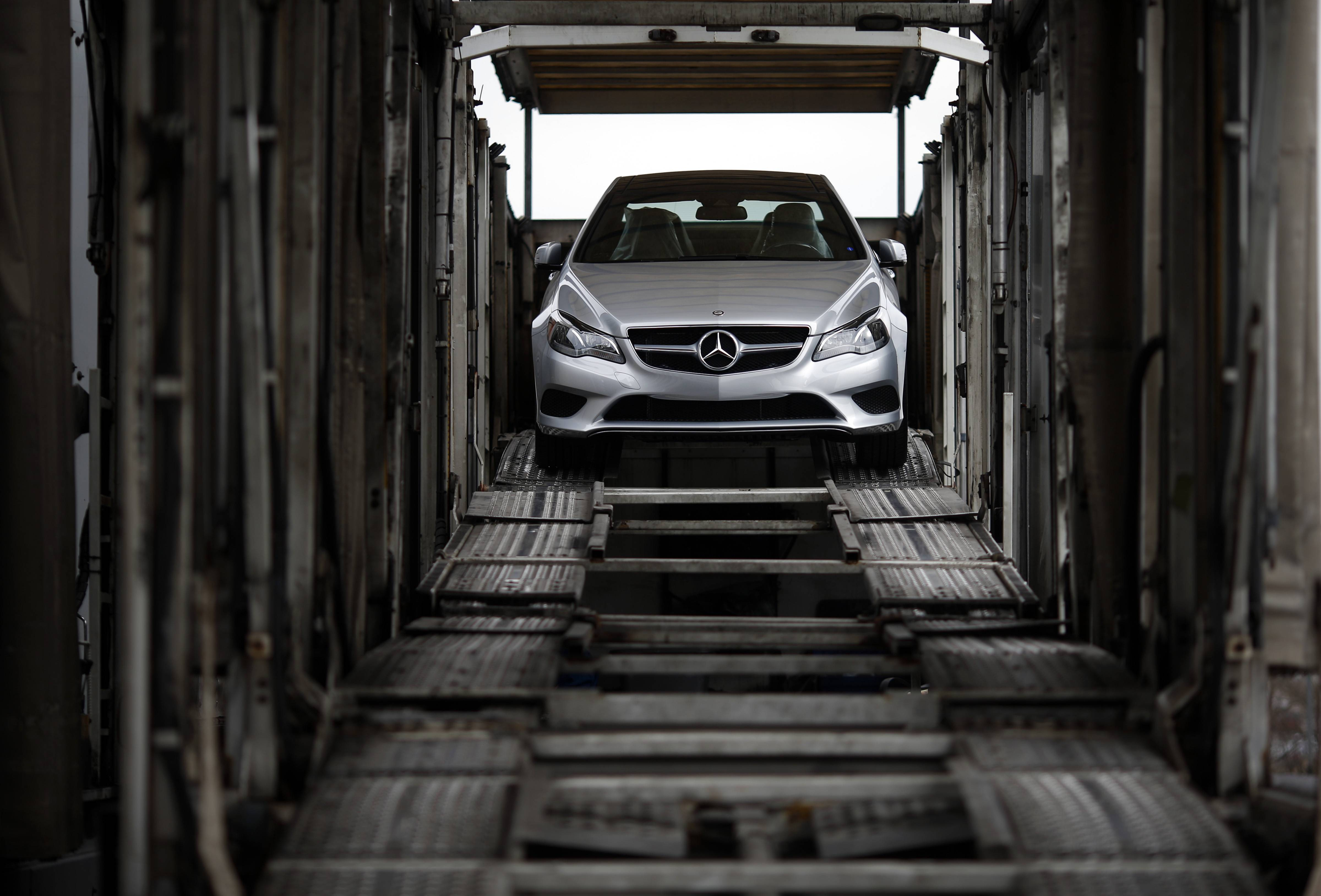 A Mercedes-Benz vehicle sits inside a car-carrier before being hauled away for distribution from the company's Vehicle Processing Center in Baltimore. After sales slumped in January and February because of the brutal weather, automakers hope a rebound in March will get them back on track to sell more than 16 million cars in the U.S. this year.