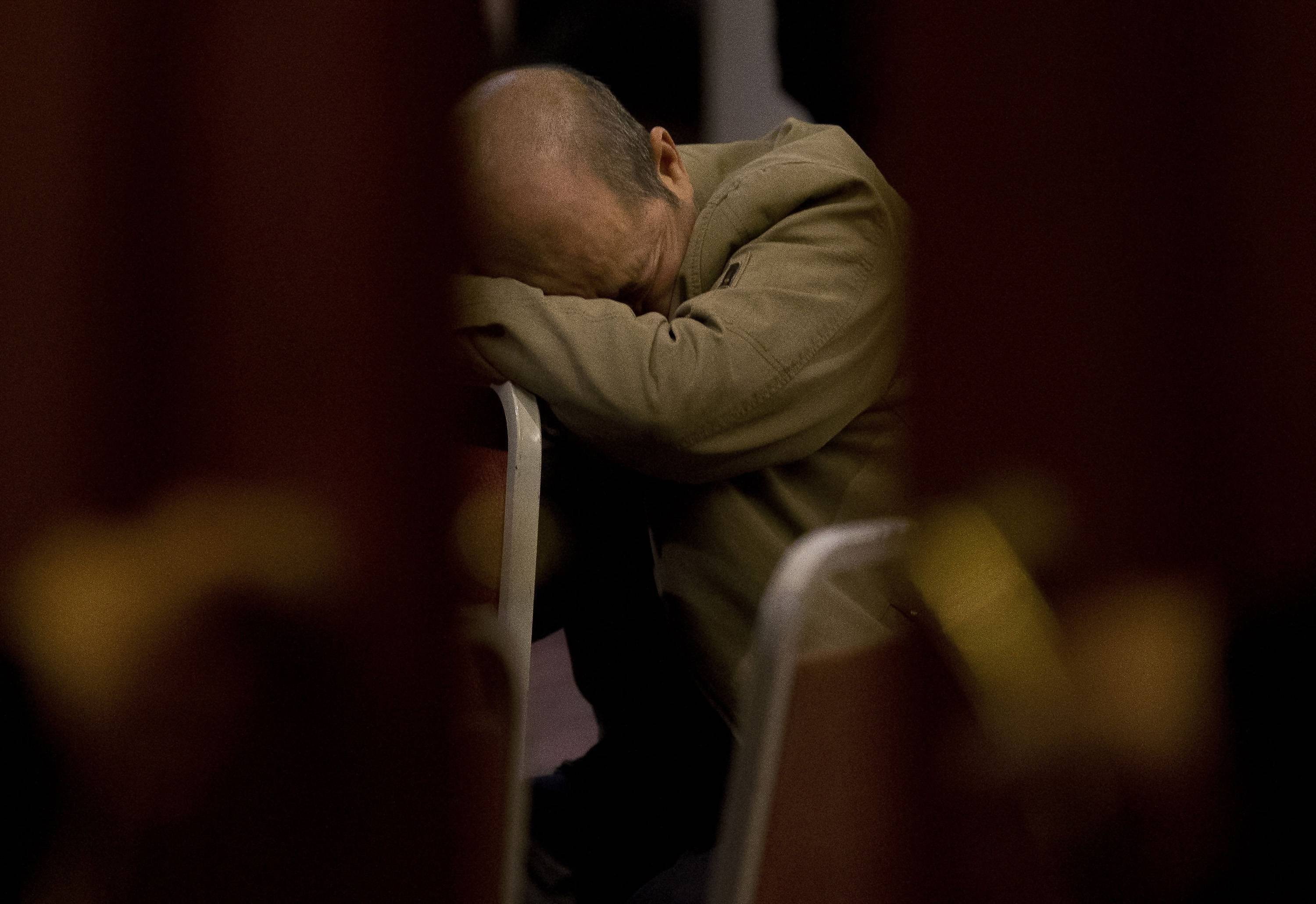 Associated PressA relative of Chinese passengers aboard the missing Malaysia Airlines Flight MH370 rests on a chair as he waits for a news briefing by the Airlines' officials at a hotel ballroom in Beijing, China.