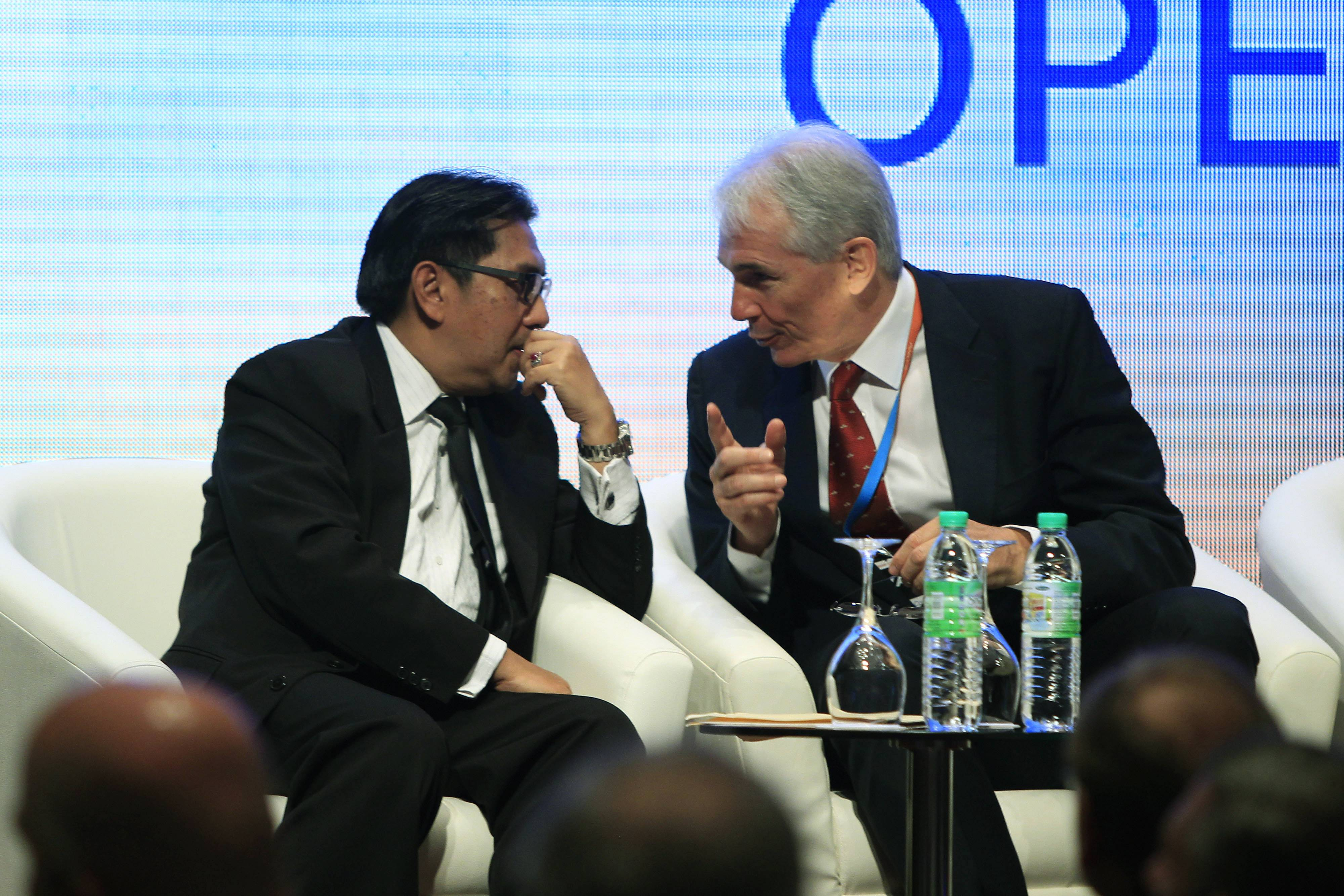 Chief Executive and Director General of the International Air Transport Association (IATA) Tony Tyler, right, talks to Malaysia's Department of Civil Aviation Director General Azharuddin Abdul Rahman during the IATA Ops Conference in Kuala Lumpur, Malaysia, Tuesday.