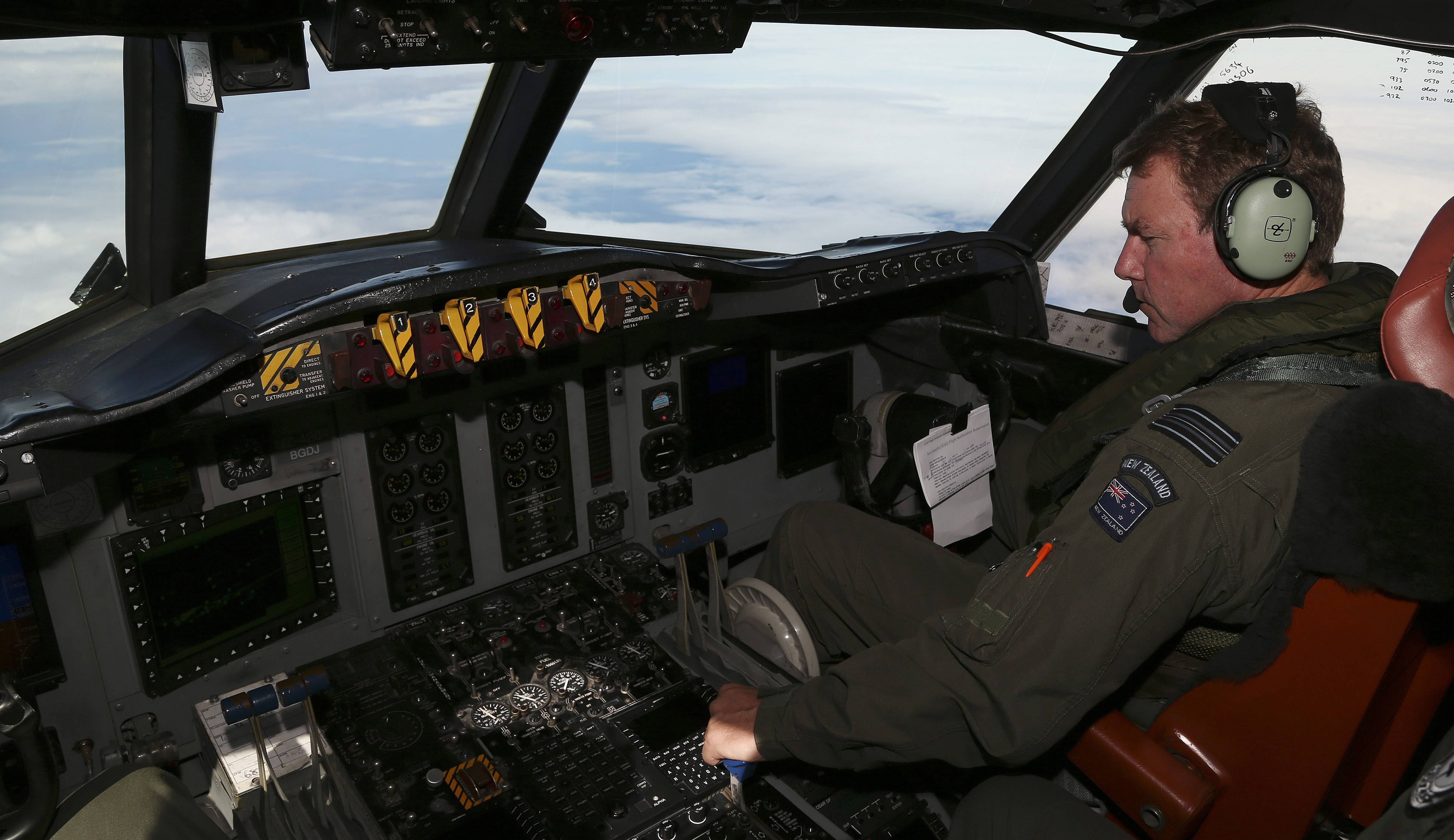 A Royal New Zealand Air Force  P-3 Orion's co-pilot and Squadron Leader Brett McKenzie controls the pane while  searching for the missing Malaysia Airlines Flight MH370 in the southern Indian Ocean, Monday.