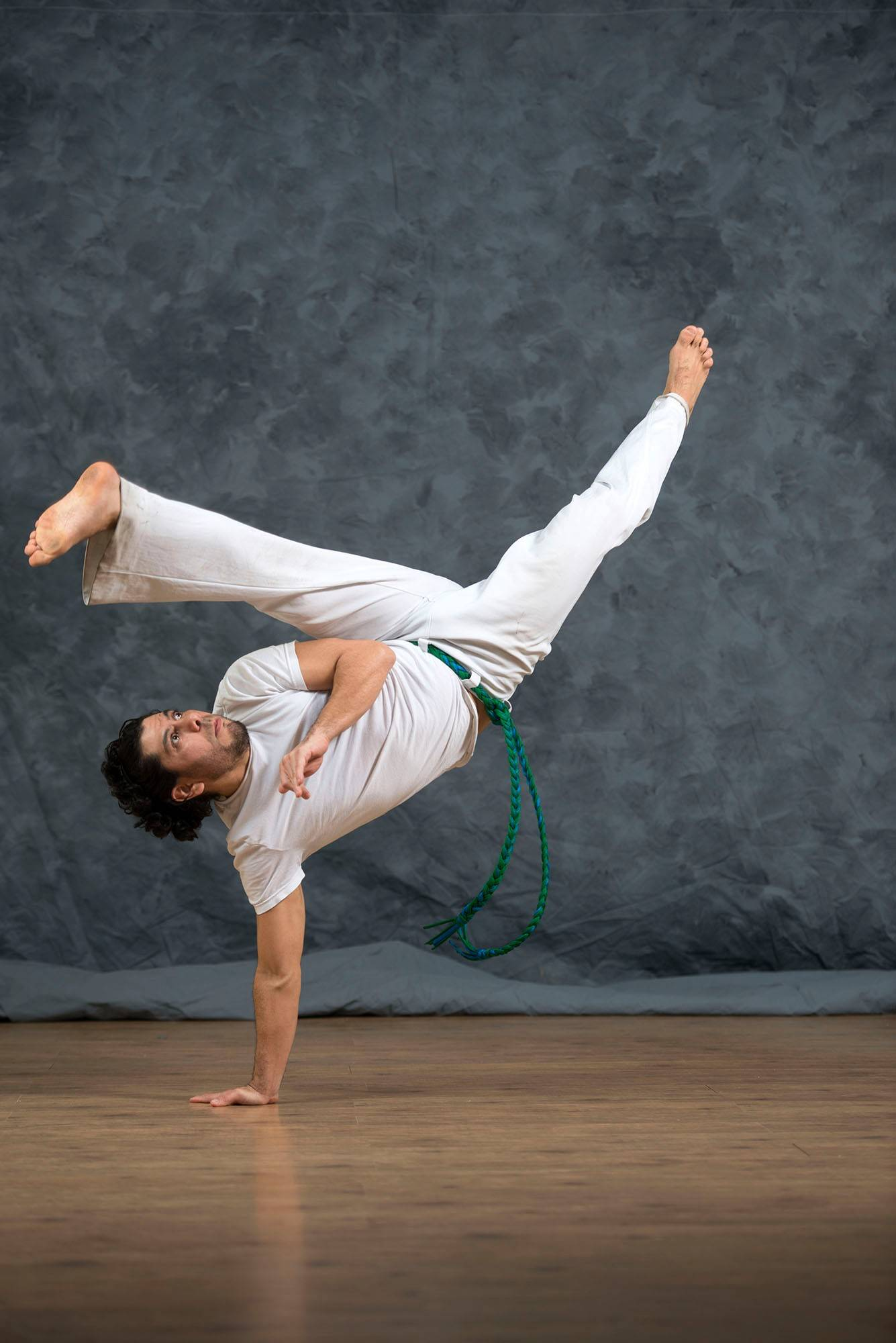 Roberto Tapia, owner of Roda Movements, demonstrates a capoeira move.