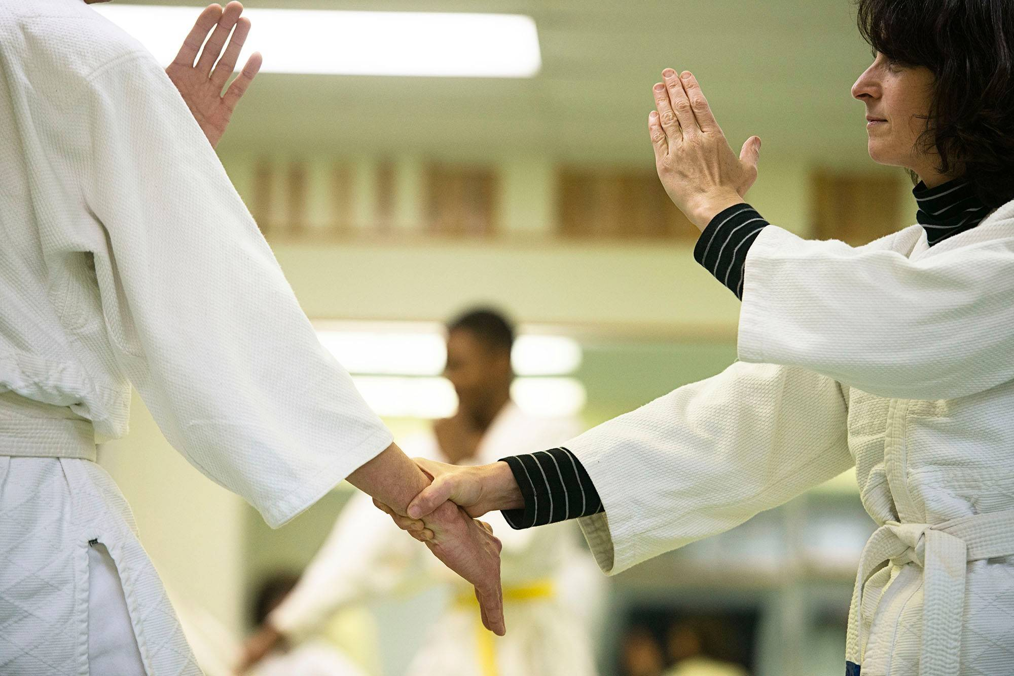 Barry Wagner, left and Jess Williams spar in an aikido class at D.C. Aikido in Washington.