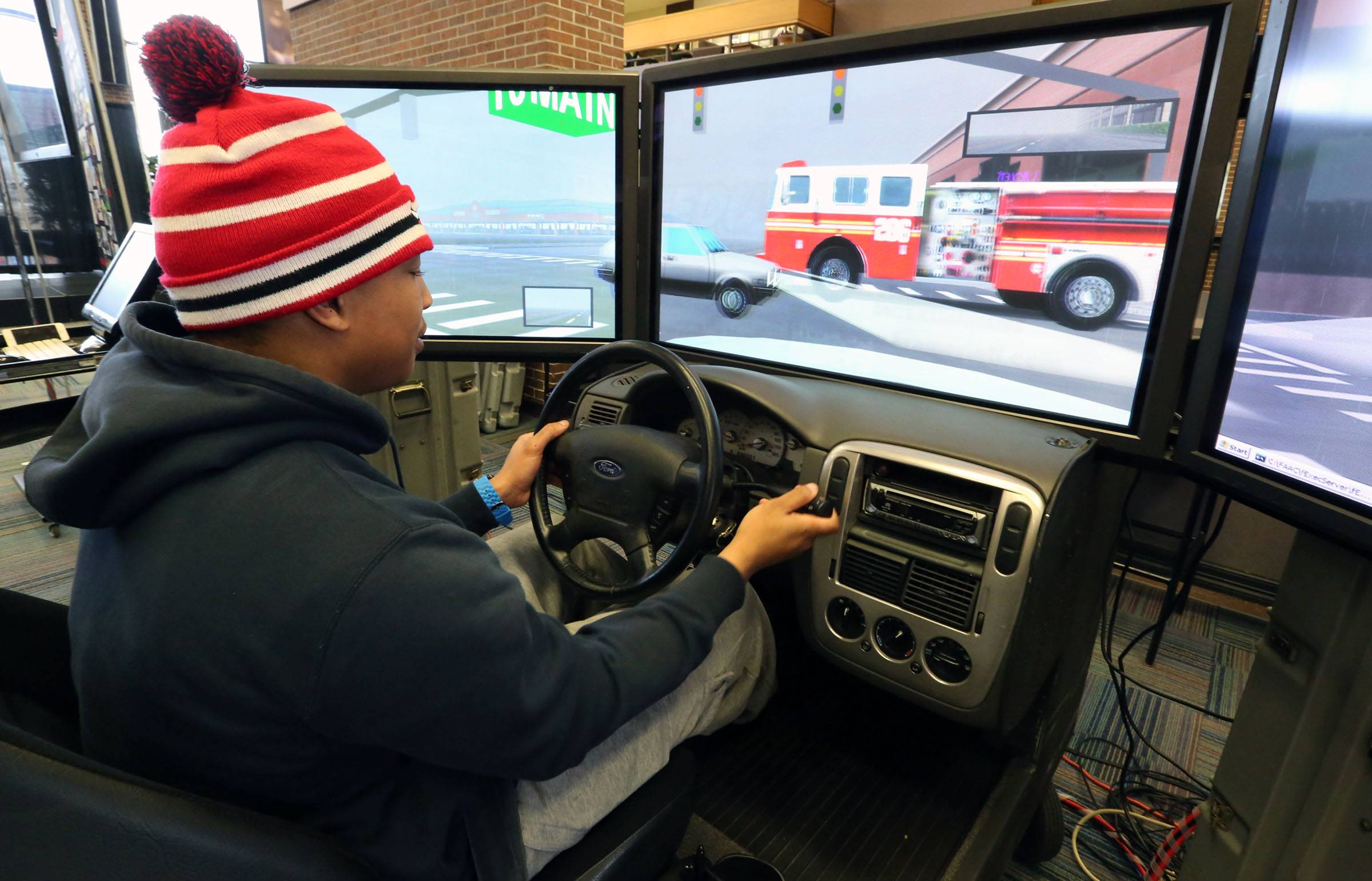 Deonte Bates, a Harper student from Palatine, tests a simulator in the student center Wednesday.